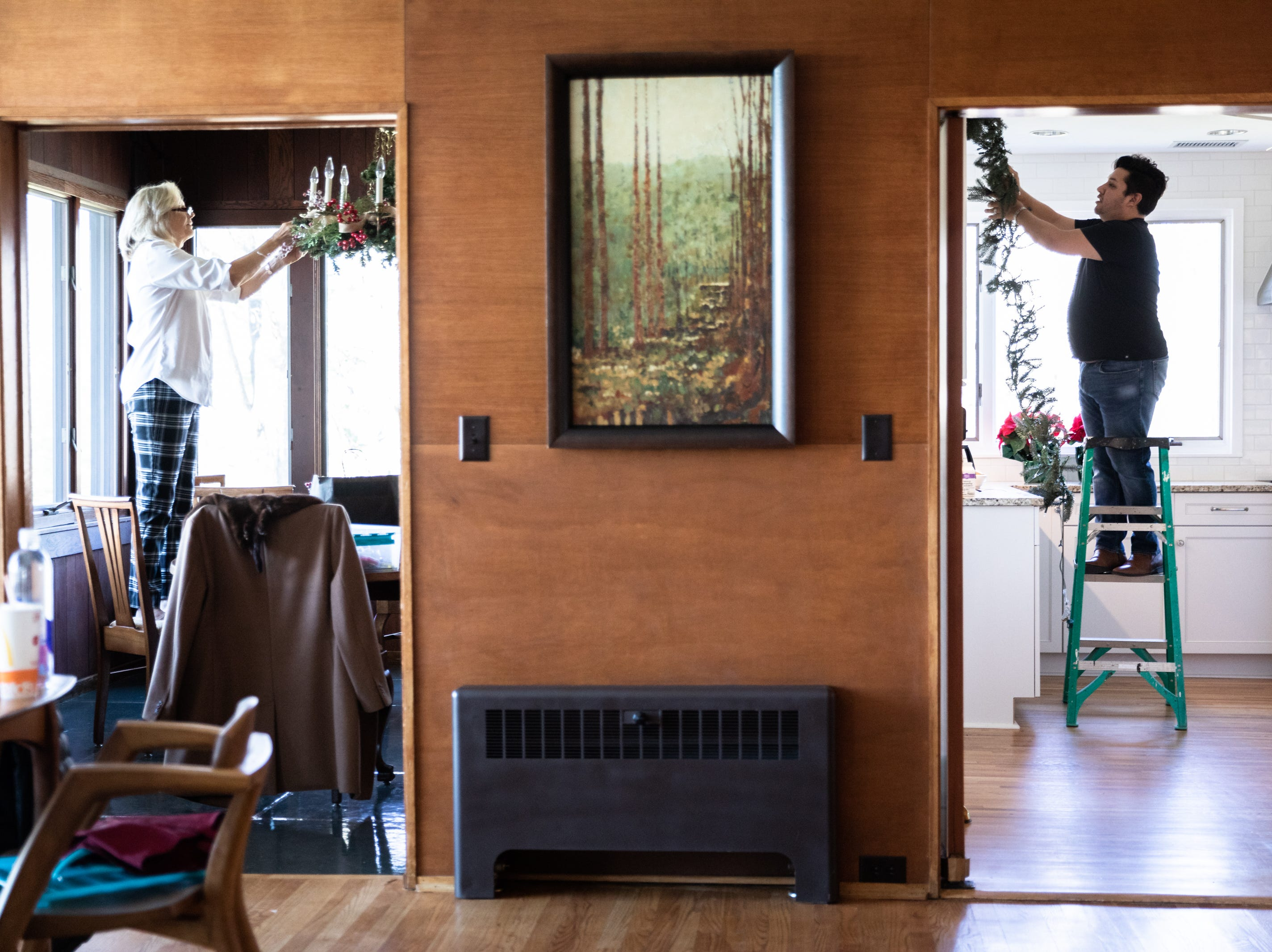 Kaye Myers, of Asheville, and Yona Wade, of the Eastern Band of Cherokee Indians, both members of the Governor's Western Residence Board of Directors, decorate the residence for the holidays Nov. 29, 2018.