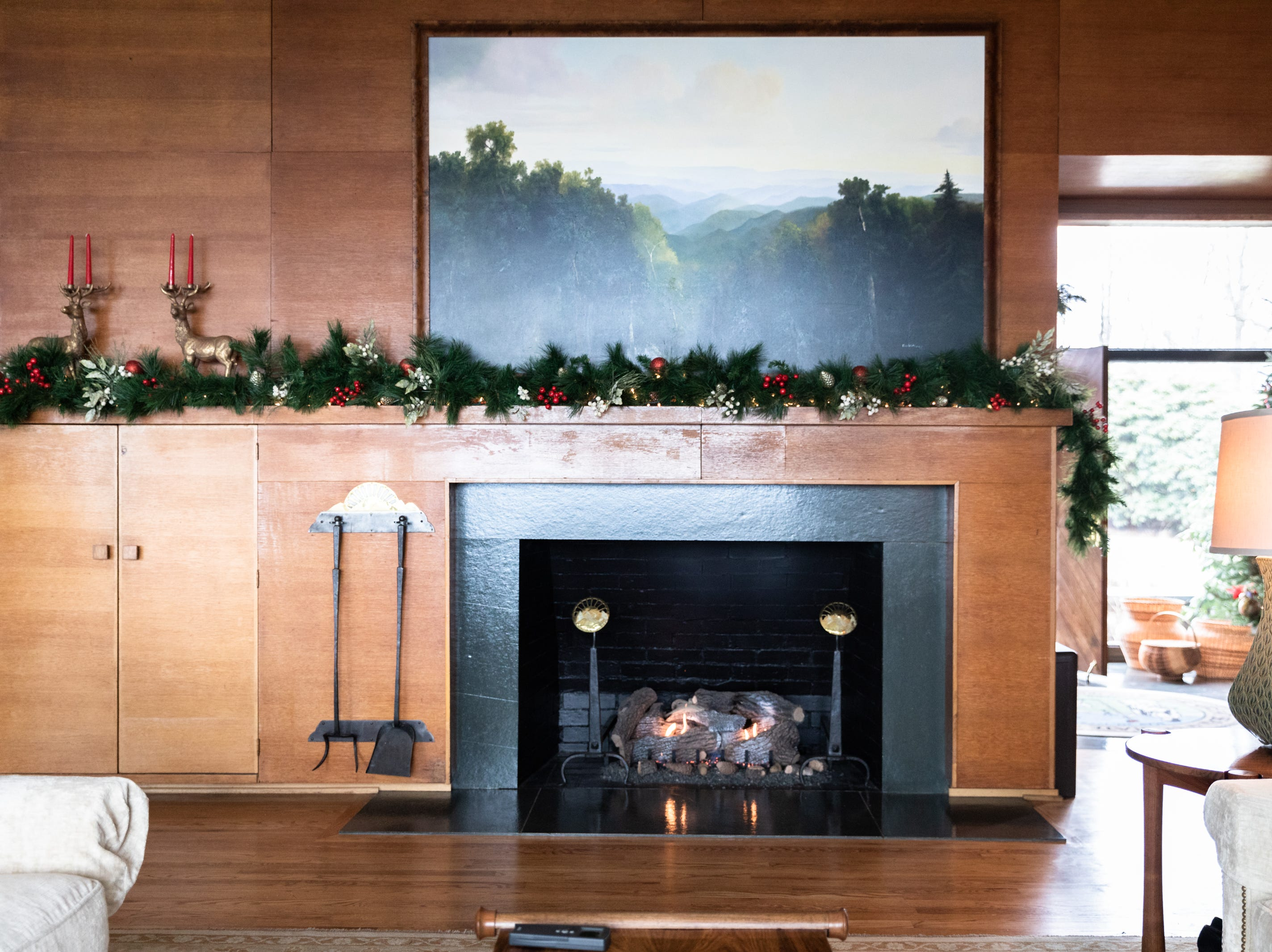 The fireplace in the living room of the Governor's Western Residence on Patton Mountain Road in Asheville, decorated for the holidays.