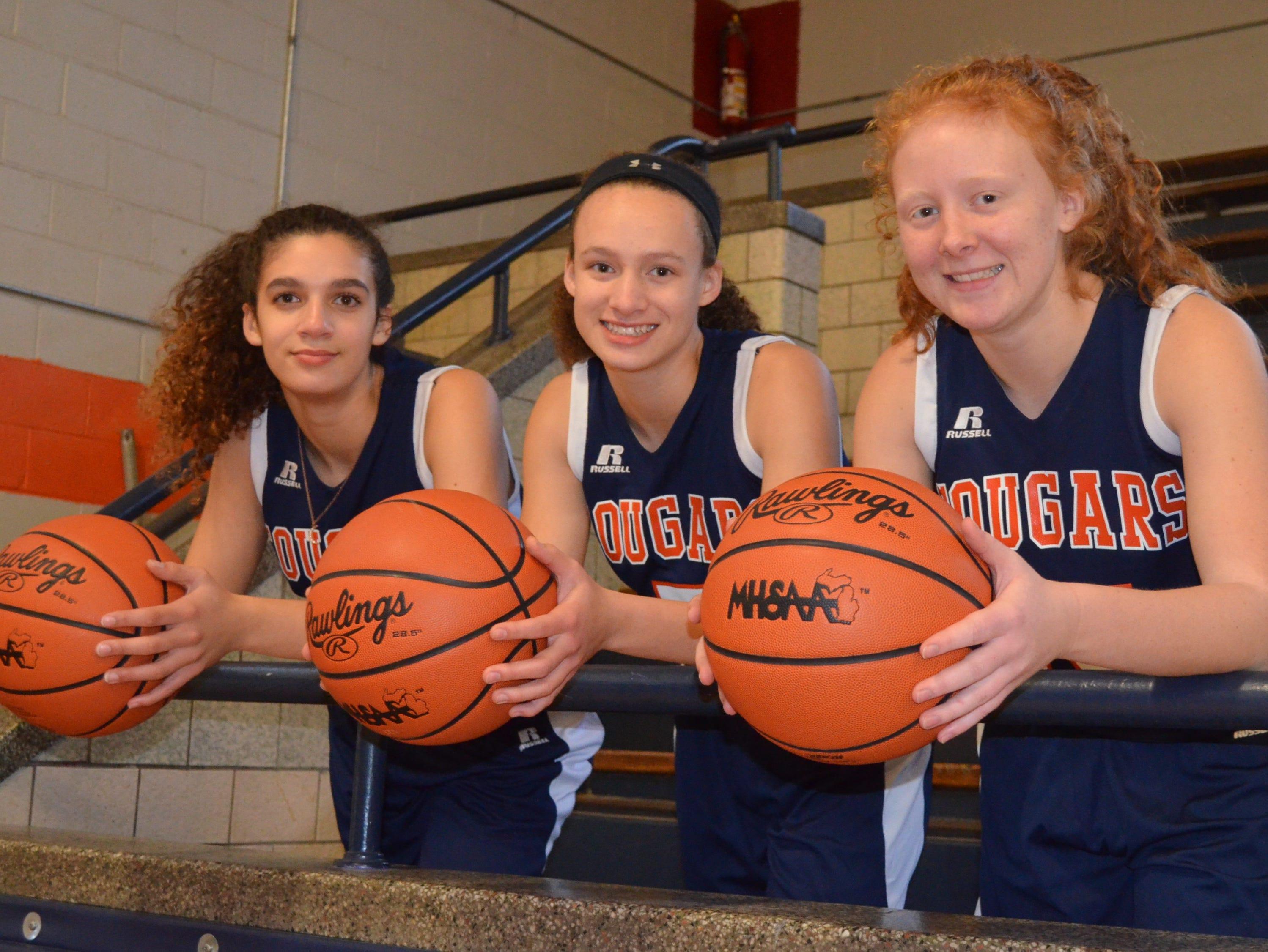 The returning leaders for the Calhoun Christian girls basketball team include, from left, Eli Wilson, Maya Wilson and Megan Follett