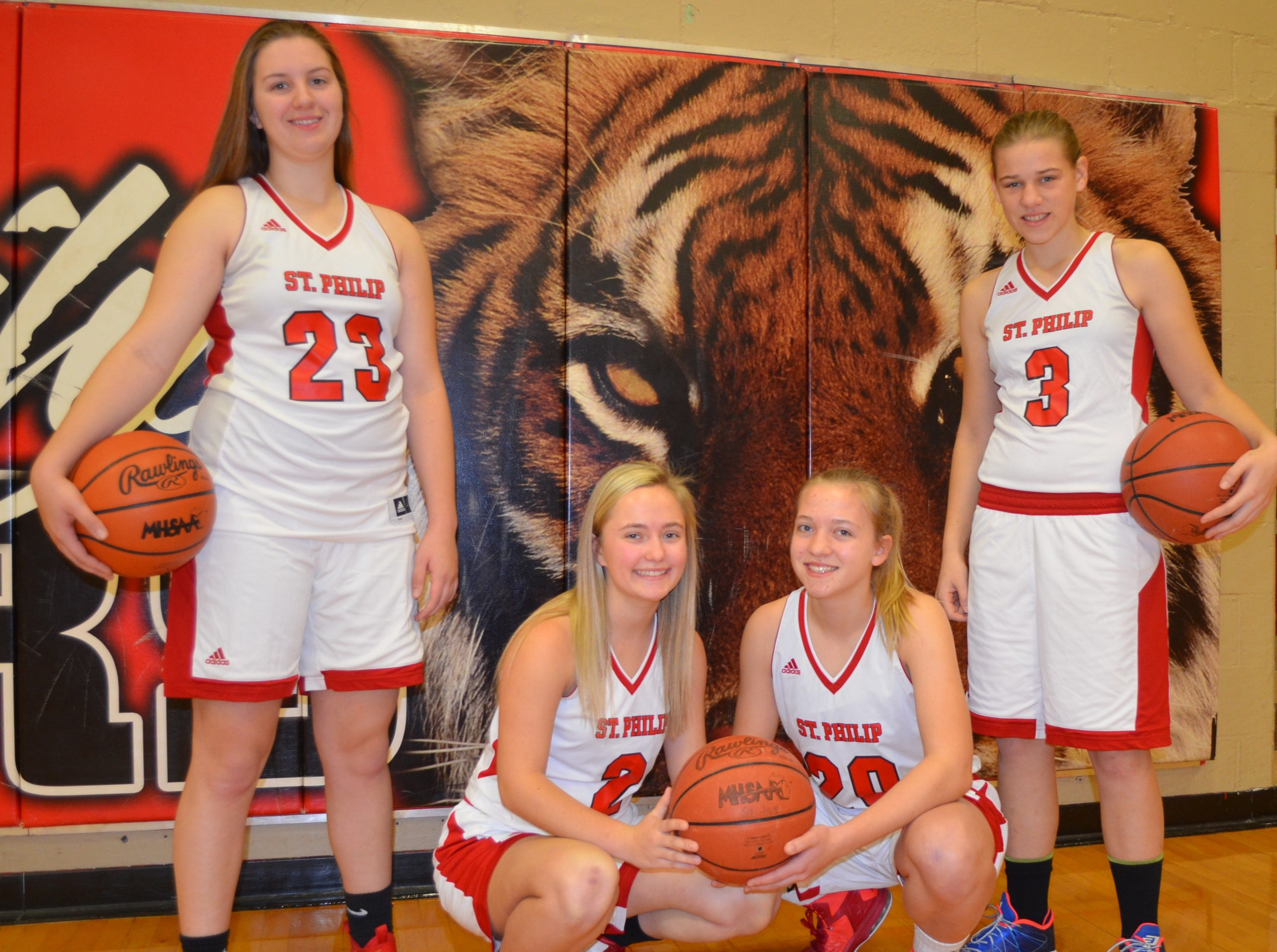 The returning leaders for the St. Philip girls basketball team include, from left, Abbie Lahr, Alex Pessetti, Elsa Mullis and Irene Hibbard.