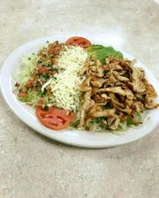 The menu at El Pulpo Mexican Restaurant & Grill features Ensalada de La Casa, a salad served with a choice of chicken, shrimp, salmon or steak.