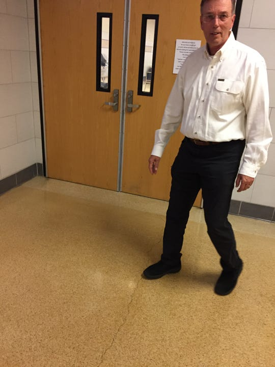 Bill Wertz, an environmental consultant, shows where technicians filled cracks in the floor last summer as a safeguard against toxic vapors below the Elmira school.