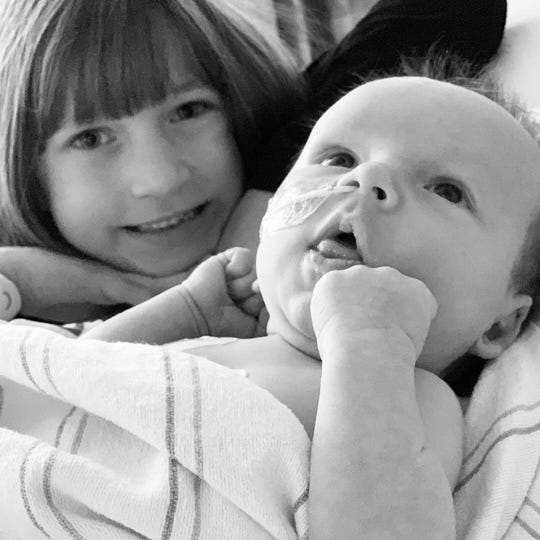 Wyatt Plew with his sister, Adrienne.
