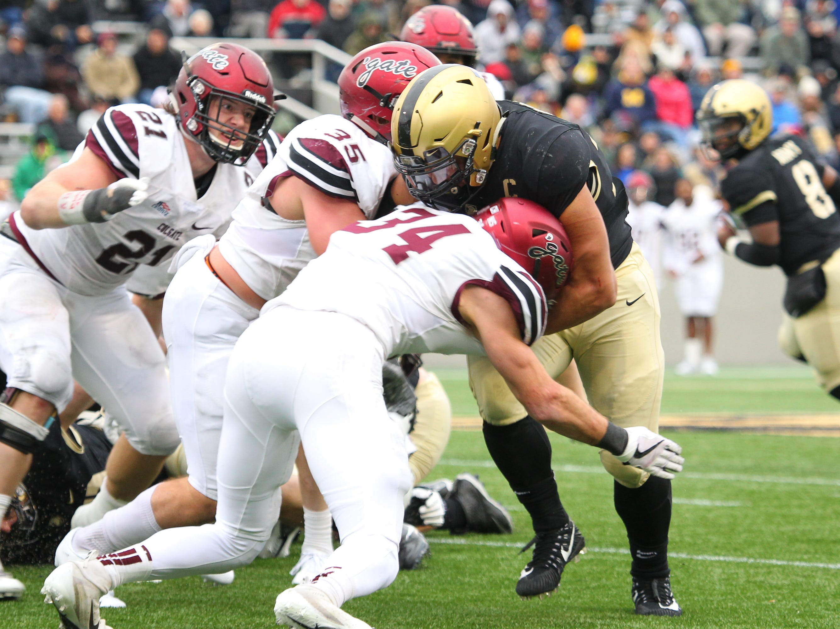 Host Army defeated Colgate, 28-14 on Nov. 17. Maine-Endwell grad Darnell Woolfolk (No. 33) finished with three touchdowns for Army. Fellow Maine-Endwell grad Alec Wisniewski (No. 34) is a starting defensive back for Colgate.