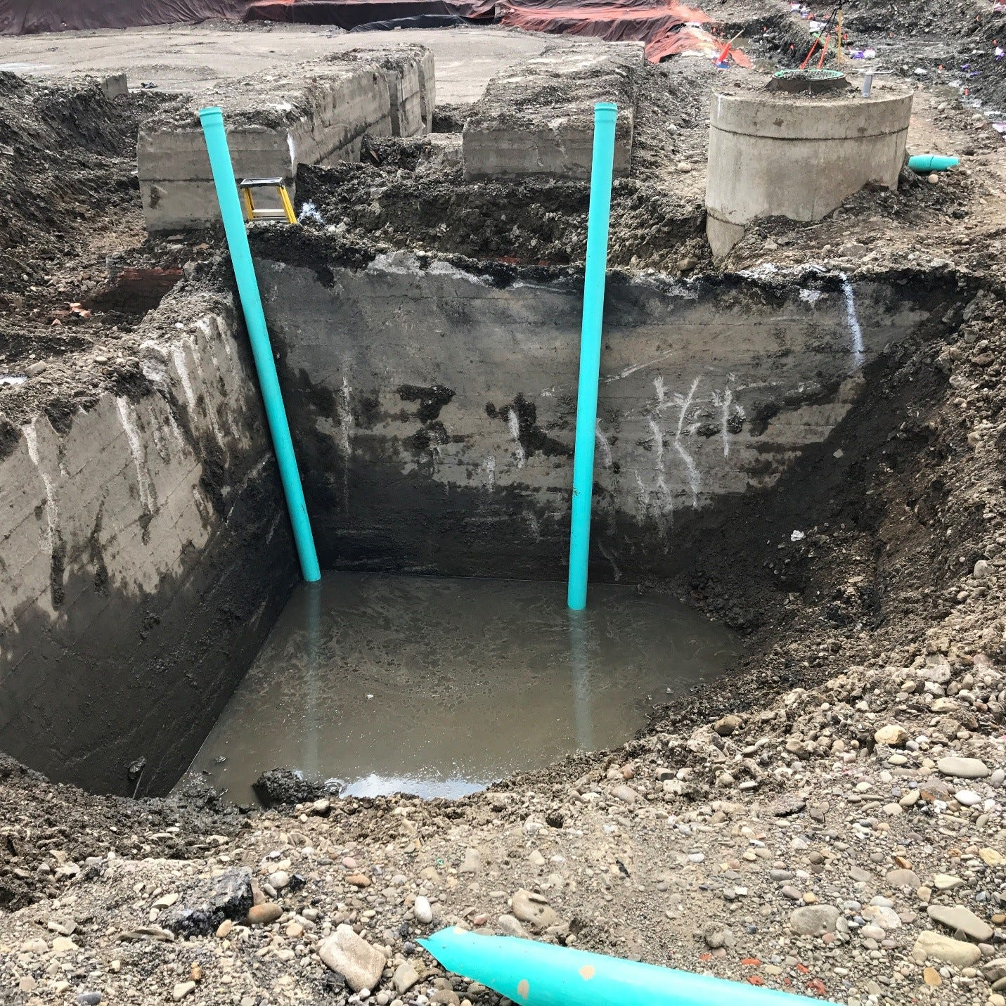 Crews cleaning PCBs from under the Elmira High School parking lot last summer unexpectedly ran into the foundation of the old Remington Rand factory.