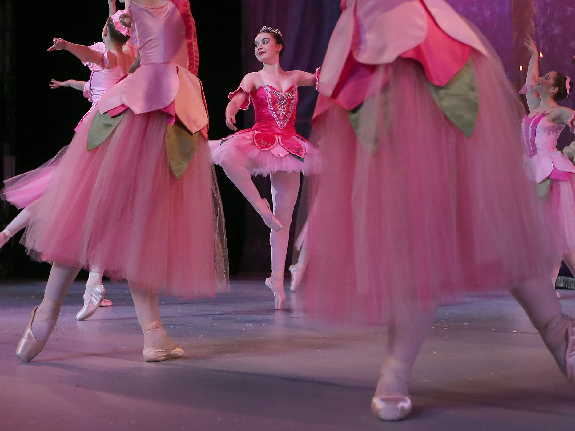 Elise Schroeder (center) dances the part of Rose during rehearsal for Peninsula Dance Theatre's annual Nutcracker production at the Bremerton Performing Arts Center on Wednesday, November 28, 2018.