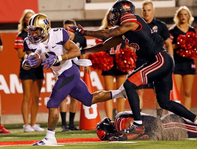 Myles Gaskin ran for 143 yards and a touchdown in Washington's 21-7 win at Utah (9) scores in front of Utah on Sept. 15. The teams meet again Friday night for the Pac-12 championship.