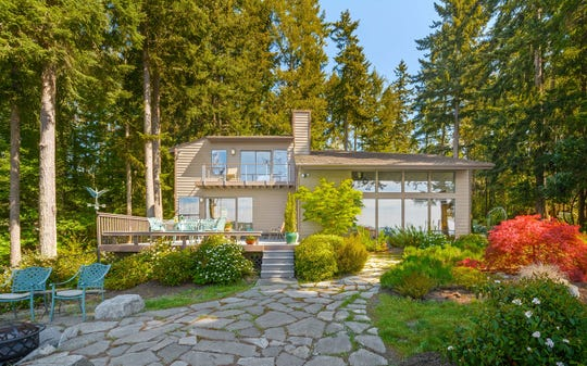 "A gated ""mini-estate"" in Poulsbo with waterfront views of Puget Sound sold for almost $1.5 million dollars in September."
