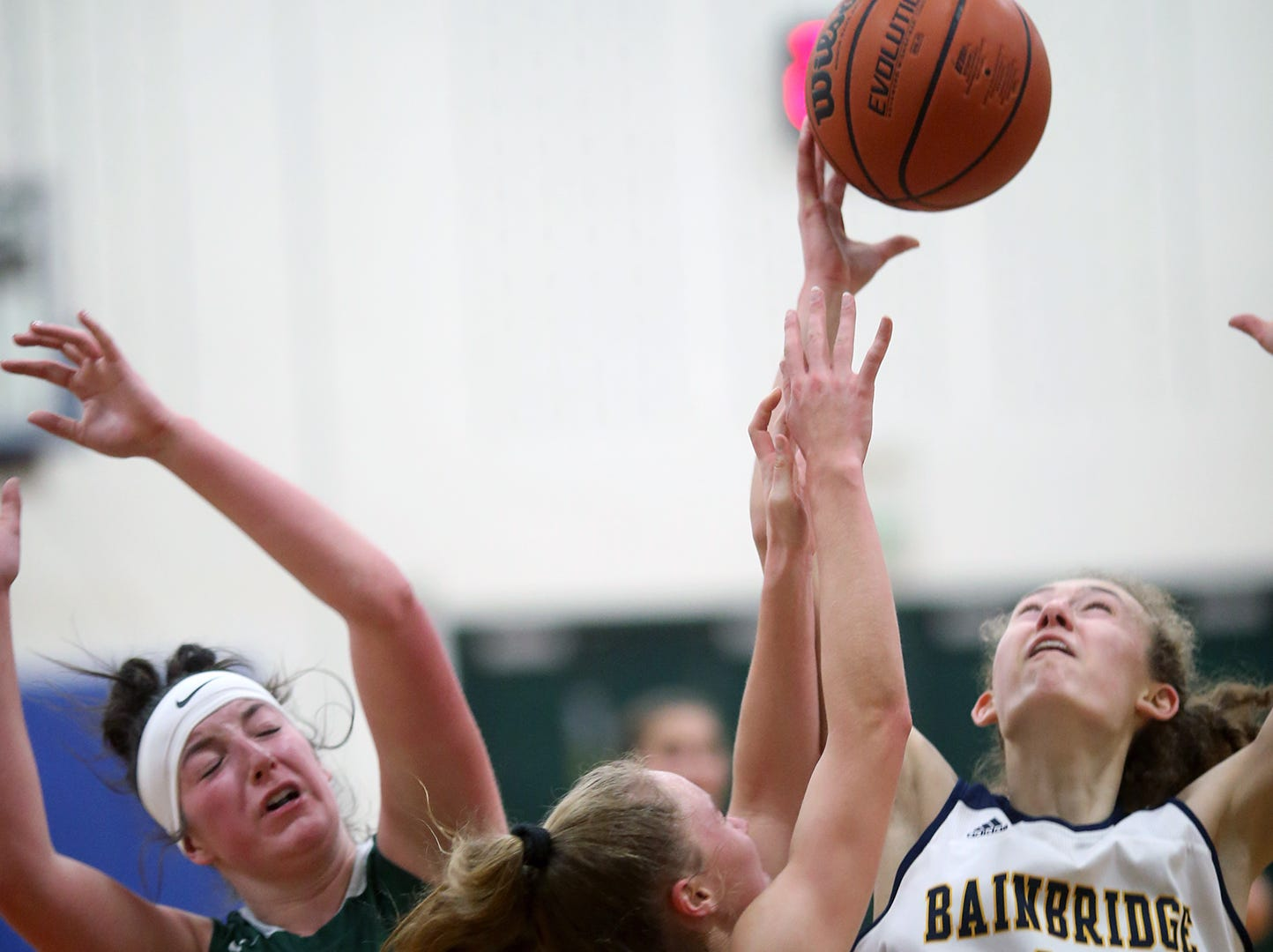 The Bainbridge girls basketball team played Port Angeles at Bainbridge, on Wednesday, Nov. 28, 2018. The Bainbridge girls basketball team played Port Angeles at Bainbridge, on Wednesday, Nov. 28, 2018. Bainbridge player Olivia Wikstrom gets a rebound from Port Angeles defender Aeverie Politika..