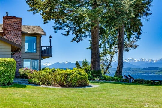"""This three bedroom, two bathroom """"heirloom quality"""" waterfront estate in Lofall with views of Hood Canal sold for $1.3 million in July."""