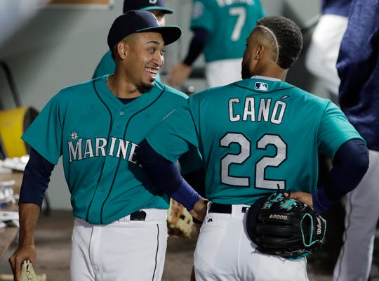 Edwin Diaz, left, and Robinson Cano after a win over Oakland in April.