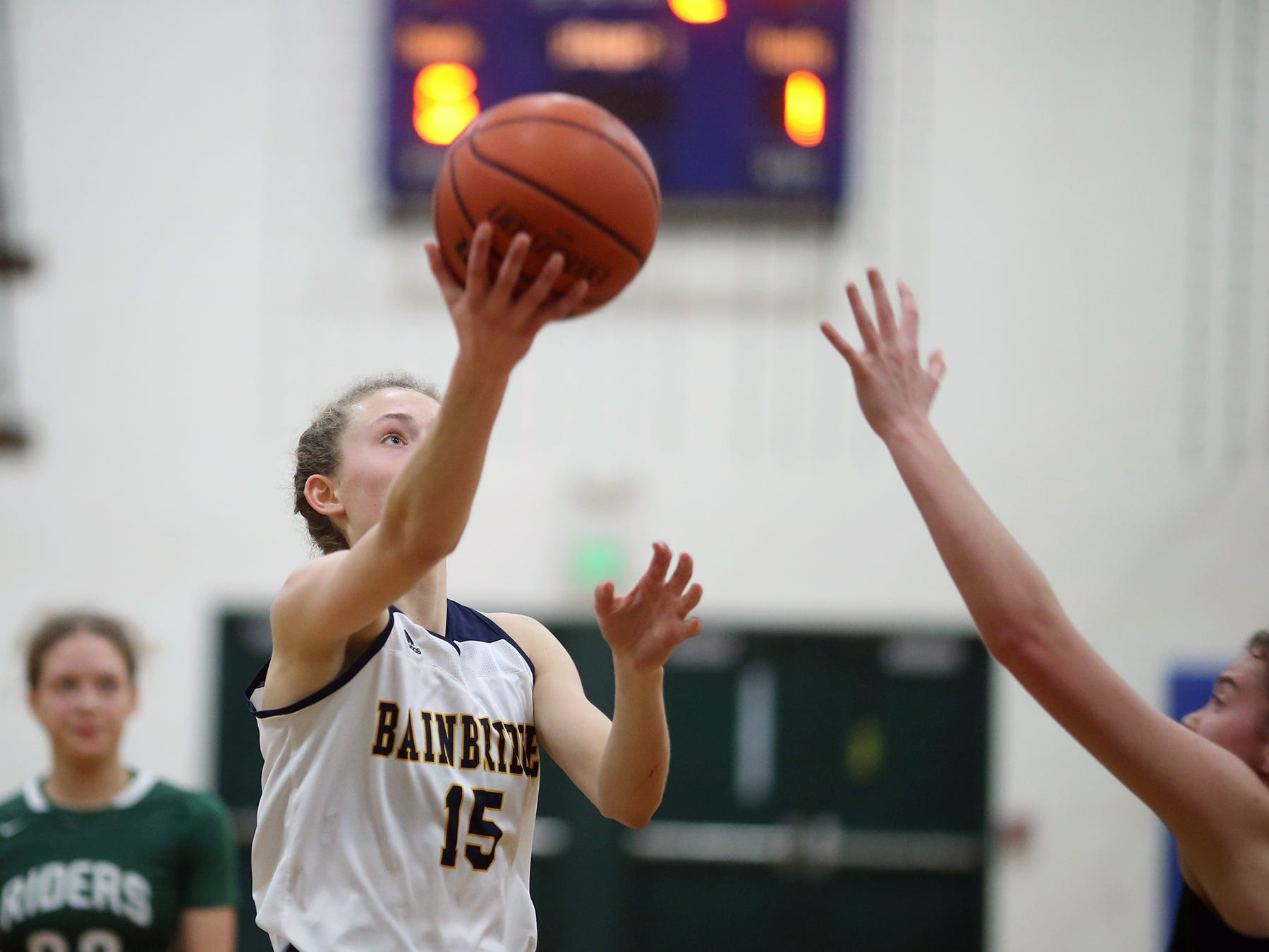 The Bainbridge girls basketball team played Port Angeles at Bainbridge, on Wednesday, Nov. 28, 2018. The Bainbridge girls basketball team played Port Angeles at Bainbridge, on Wednesday, Nov. 28, 2018. Bainbridge player Olivia Wikstrom drives to the hoops  past a Port Angeles defender .