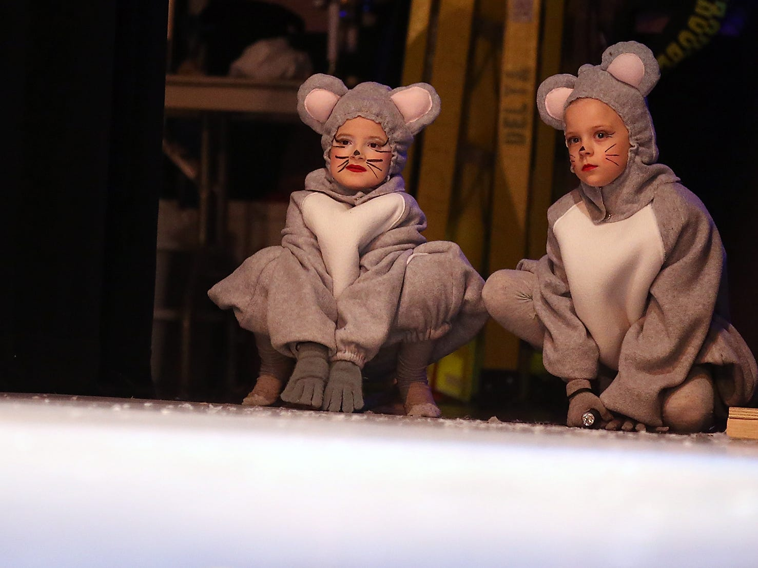 A pair of mice dancers await their cue side stage during Peninsula Dance Theatre's The Nutcracker rehearsal at the Bremerton Performing Arts Center on Wednesday, November 28, 2018.