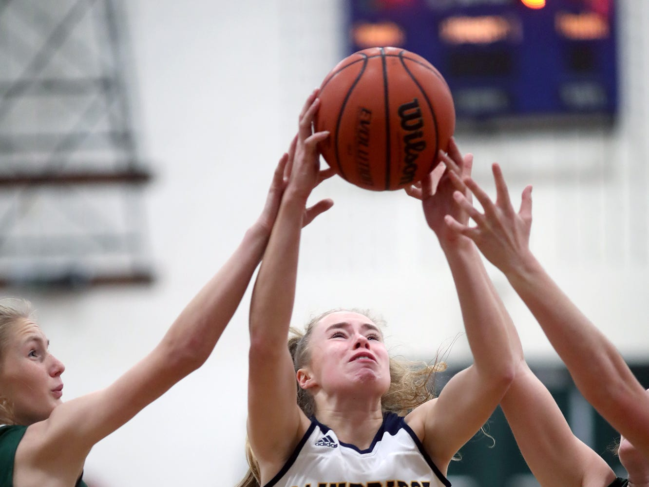 The Bainbridge girls basketball team played Port Angeles at Bainbridge, on Wednesday, Nov. 28, 2018. Bainbridge player Lea Wolf, grabs a rebound against Port Angeles.