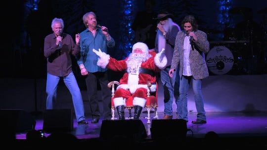 From left, Joe Bonsall, Duane Allen, William Lee Golden and Richard Sterban serenade Santa.