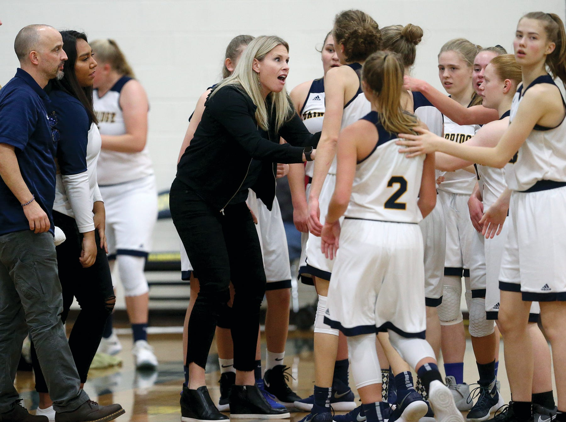 The Bainbridge girls basketball team played Port Angeles at Bainbridge, on Wednesday, Nov. 28, 2018. Bainbridge head coach Karen Byers pumps up team during a time out against Port6 Angeles.