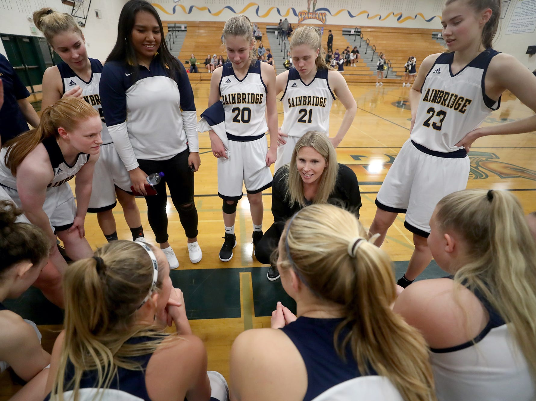 The Bainbridge girls basketball team played Port Angeles at Bainbridge, on Wednesday, Nov. 28, 2018. Head coach Karen Byers, gives instructions  before tip off.