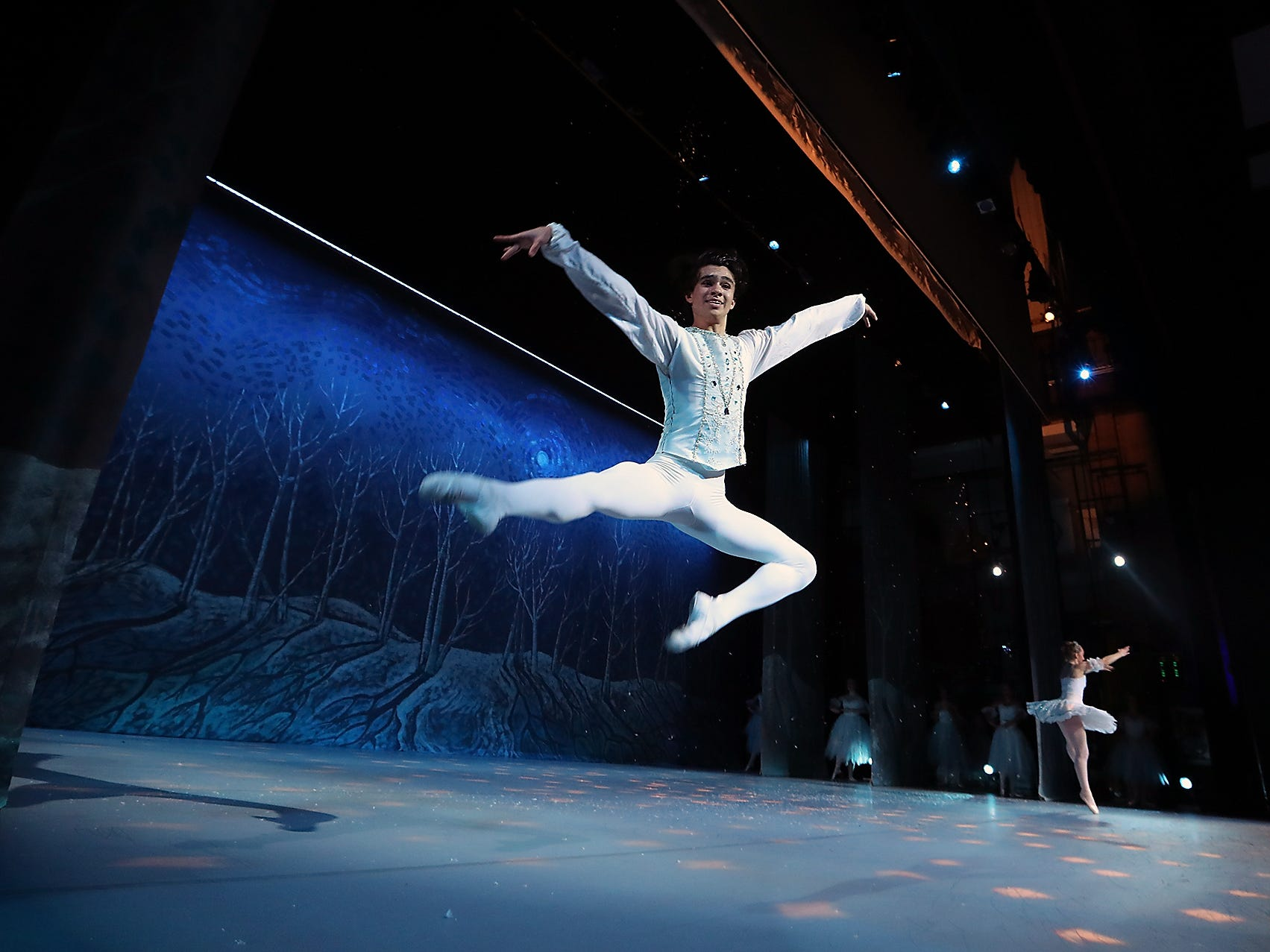 Peninsula Dance Theatre's Jacob Soltero leaps across the stage as he dances the part of the Snow King during rehearsal for the annual The Nutcracker production at the Bremerton Performing Arts Center on Wednesday, November 28, 2018. Performances take place Friday Nov 30th- 7:30 p.m., Saturday Dec 1st - 7:30 p.m. and Sunday Dec 2nd - 3:00 p.m.