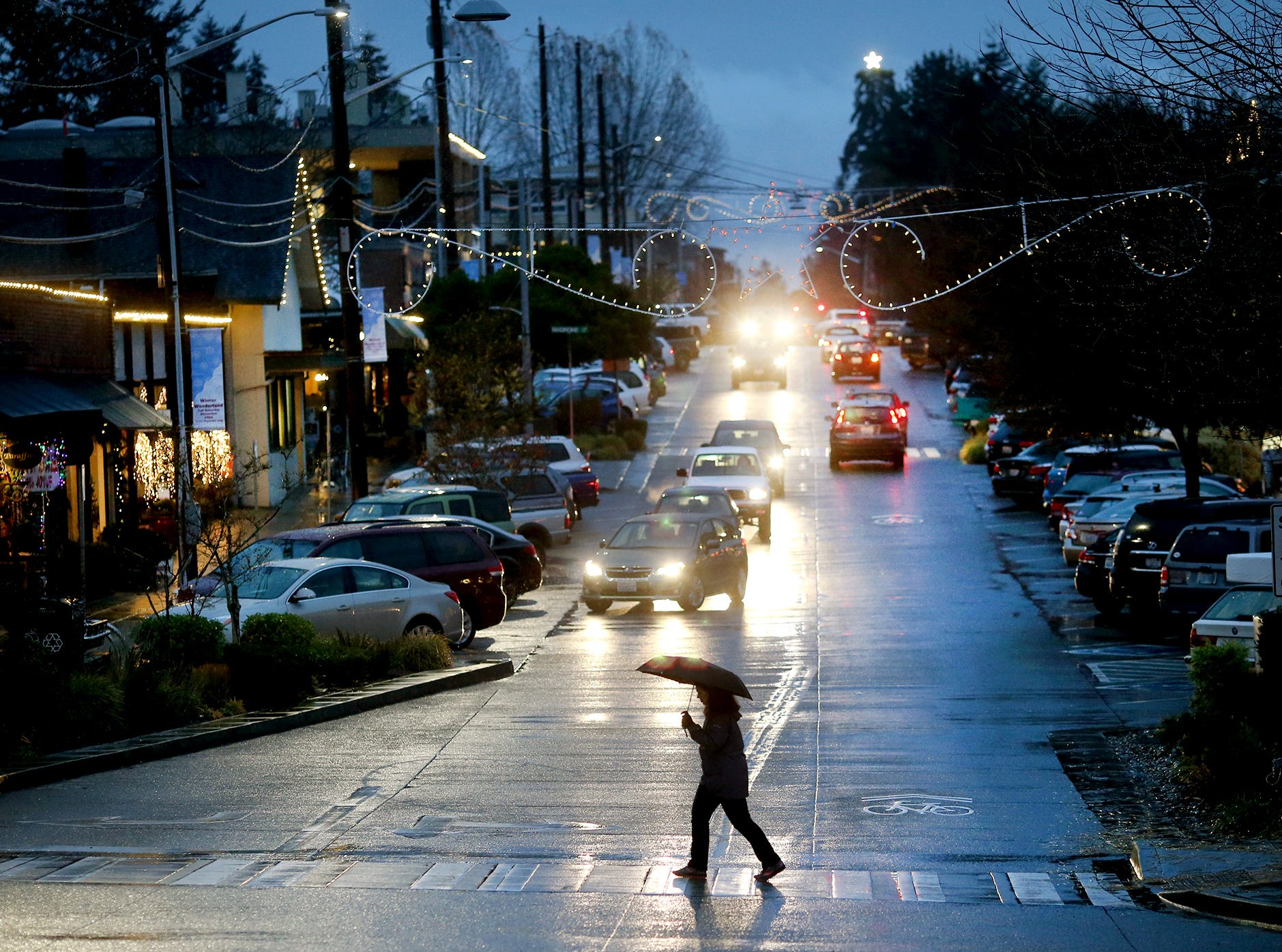 Dark days and rain along Winslow Way and Madison on Bainbridge Island, on Wednesday, November 28, 2018.