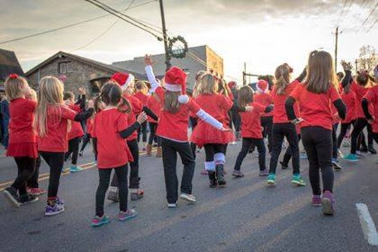 Led by Amy Maze, dancers from the Black Mountain Center for the Arts perform a routine during Holly Jolly in 2017.