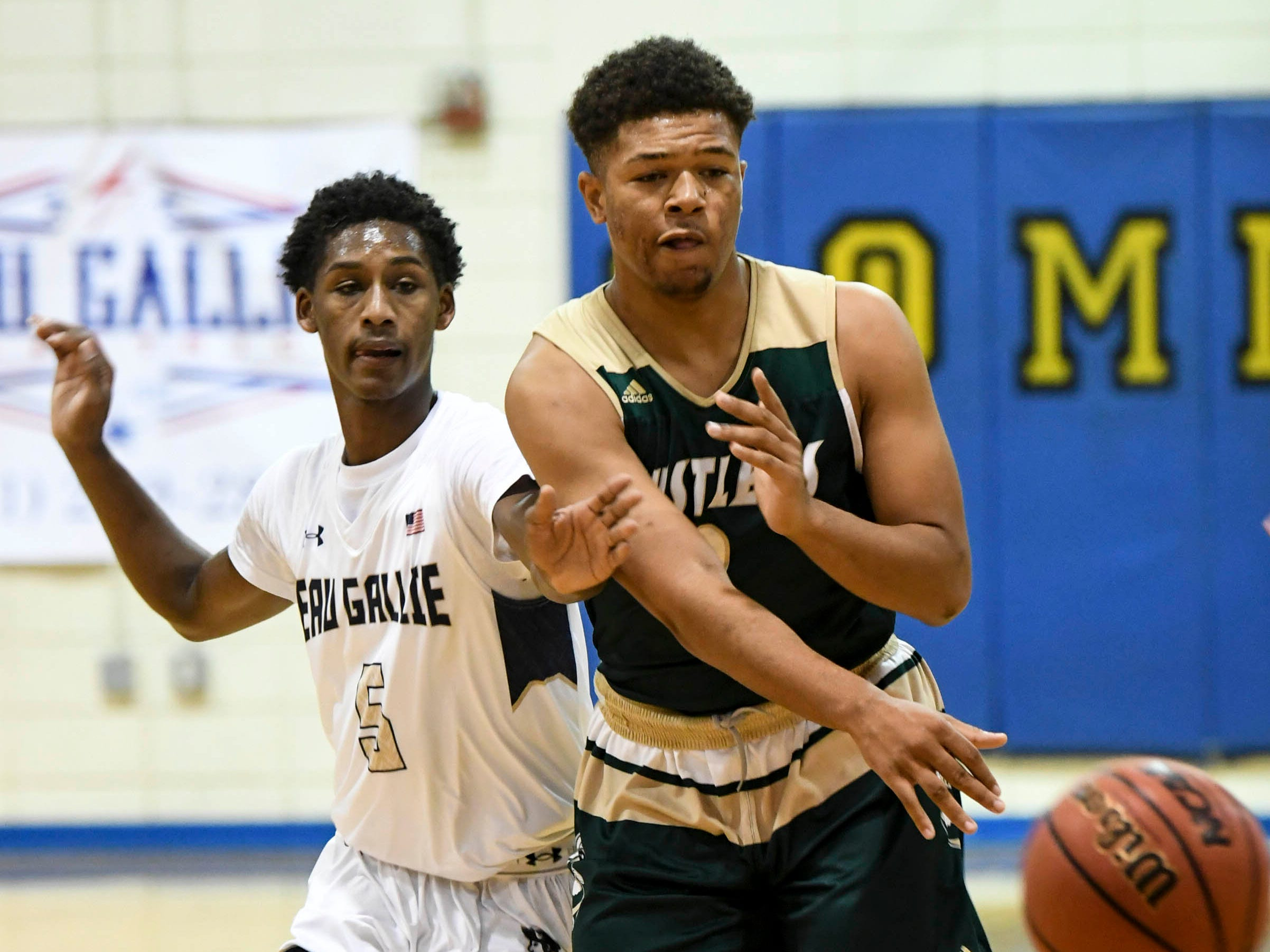 Ronaldo Ross of MCC passes away from Davon Sistrunk of Eau Gallie during Wednesday's game at Eau Gallie High