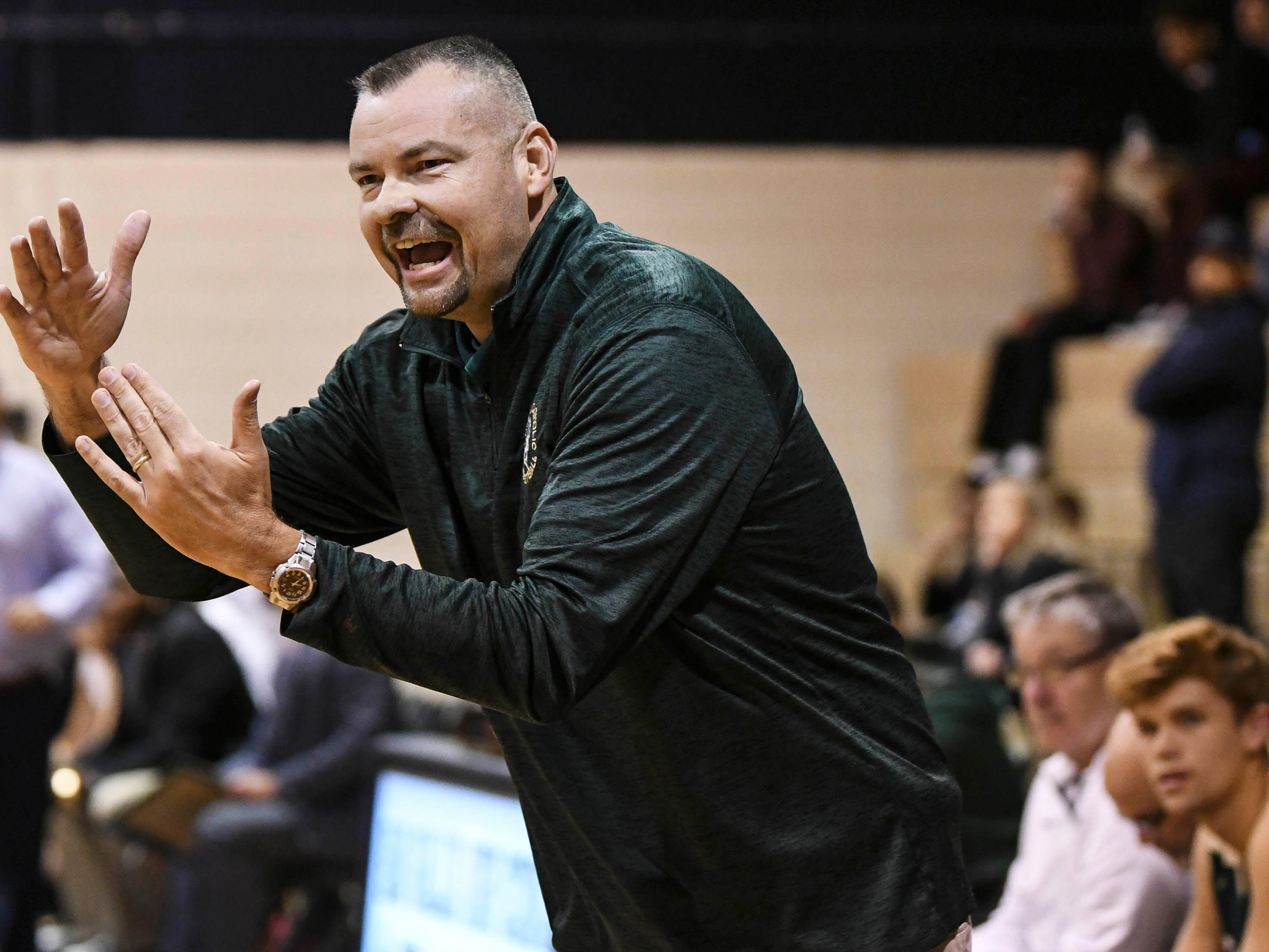 MCC basketball head coach Brett Terry calls for a timeout during Wednesday's game at Eau Gallie High
