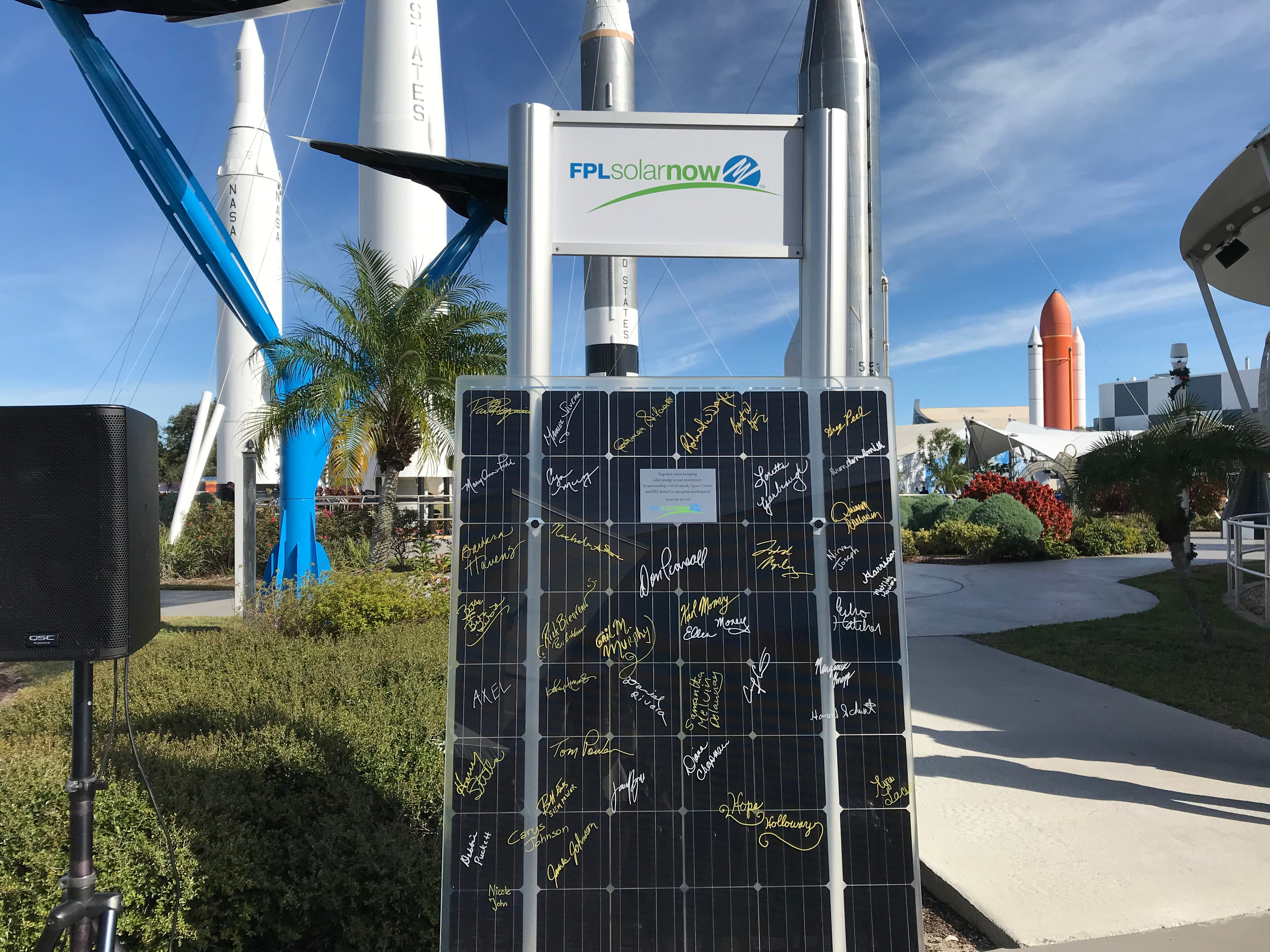 Signatures of Florida Power & Light SolarNow participants on the decorative solar panel at Kennedy Space Center Visitor Complex.