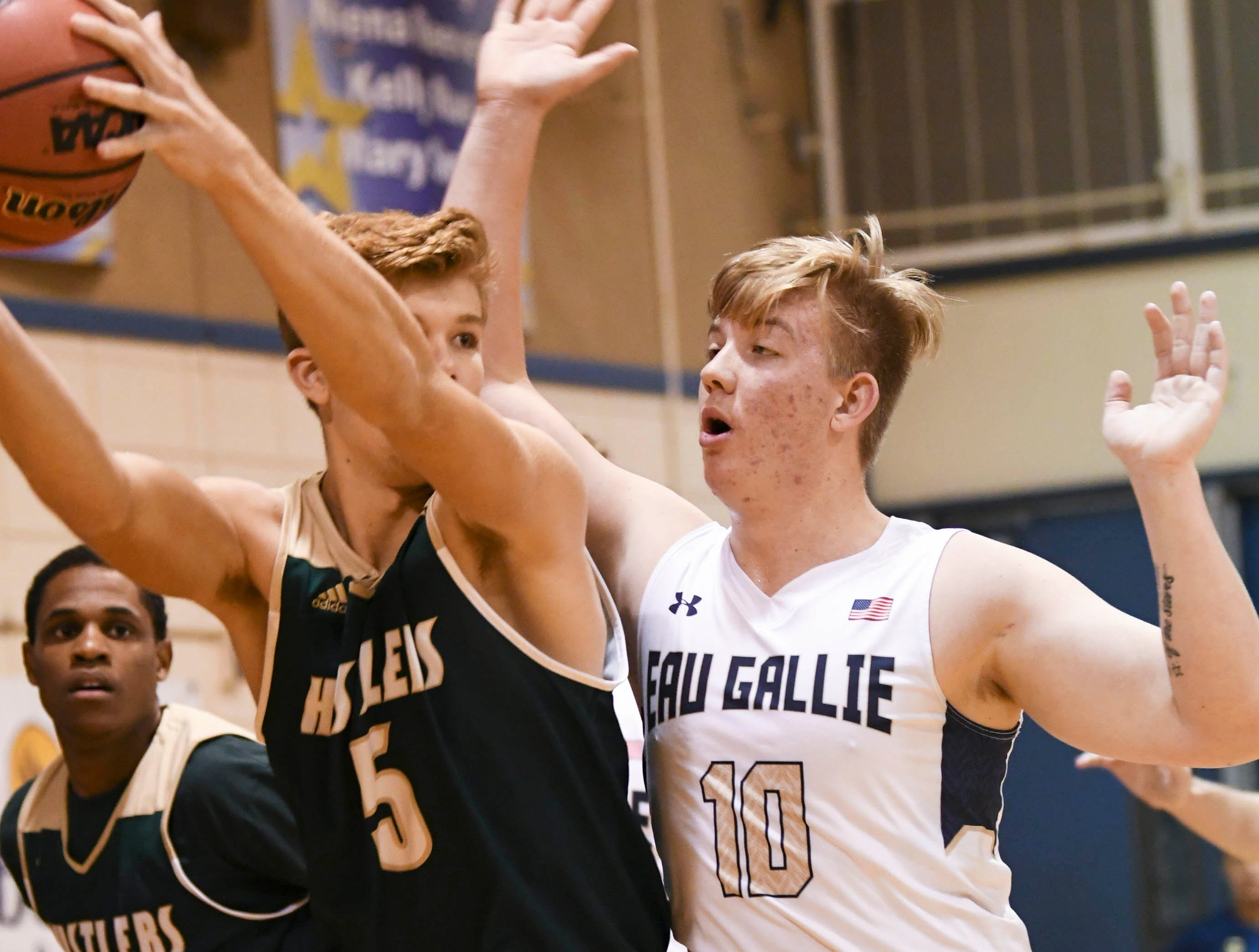 Eau Gallie's Sam Teter guards Mike Carley of MCC during Wednesday's game at Eau Gallie.