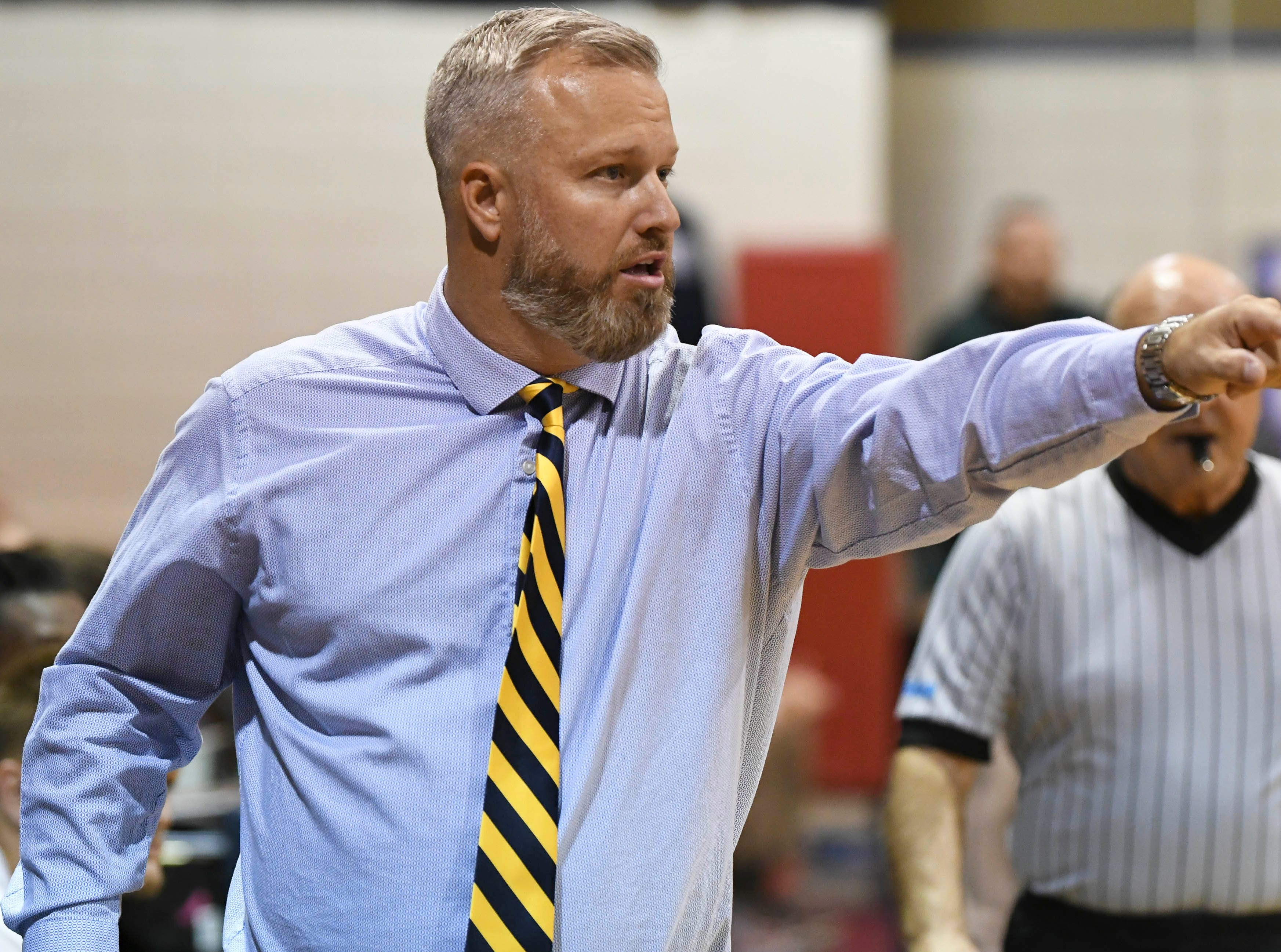 Eau Gallie basketball coach Brad Lustic directs his players during Wednesday's game at Eau Gallie High
