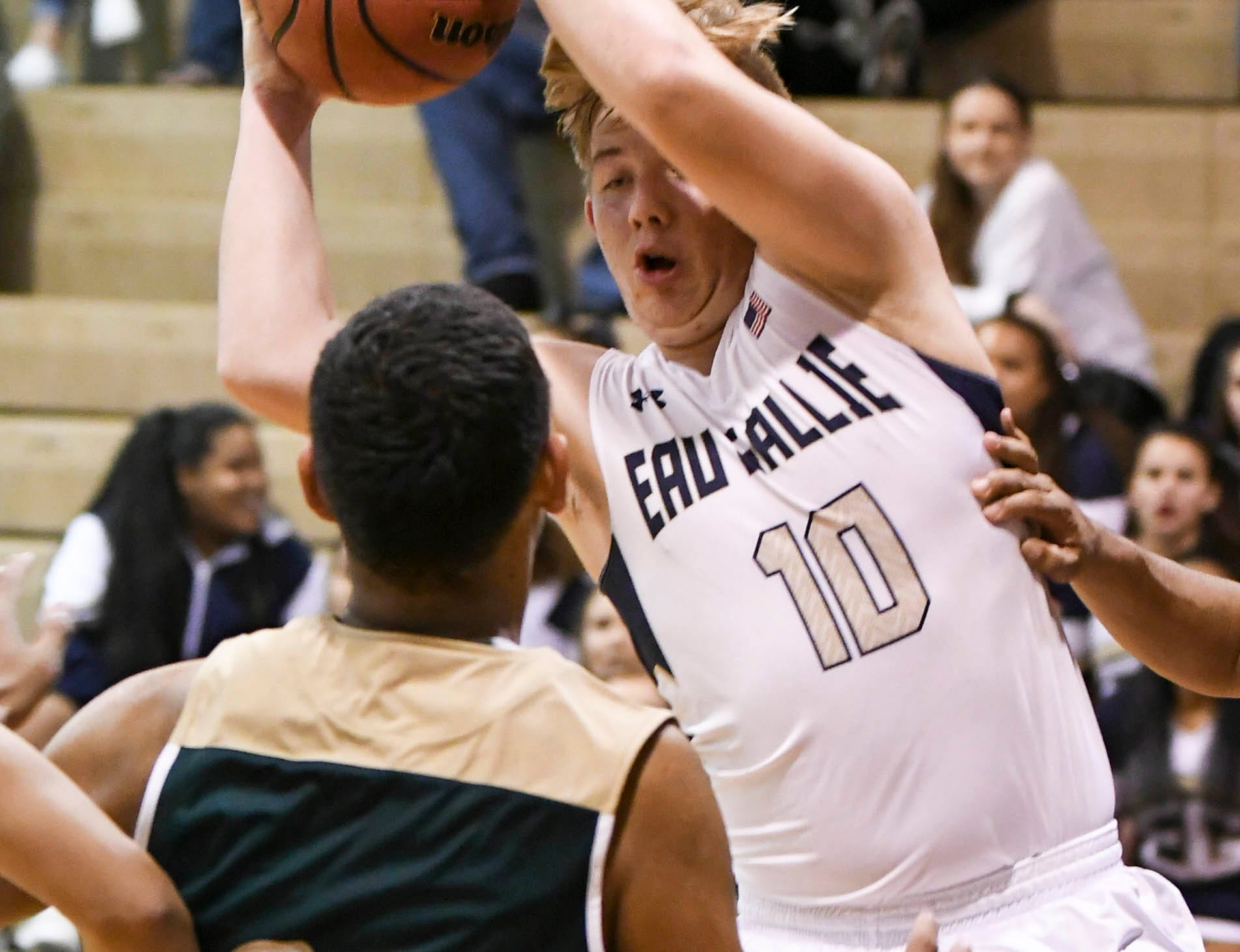 Sam Teter of Eau Gallie grabs a rebound during Wednesday's game against MCC.