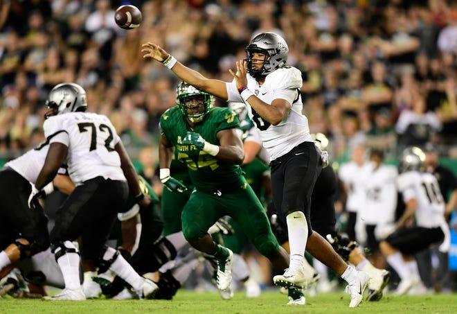 UCF quarterback Darriel Mack Jr. throws a pass against South Florida last week in Tampa.