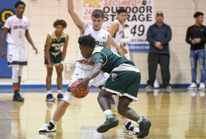 Eau Gallie's Ronaldo Ross guards De'Andre Cofield of MCC during Wednesday's game.