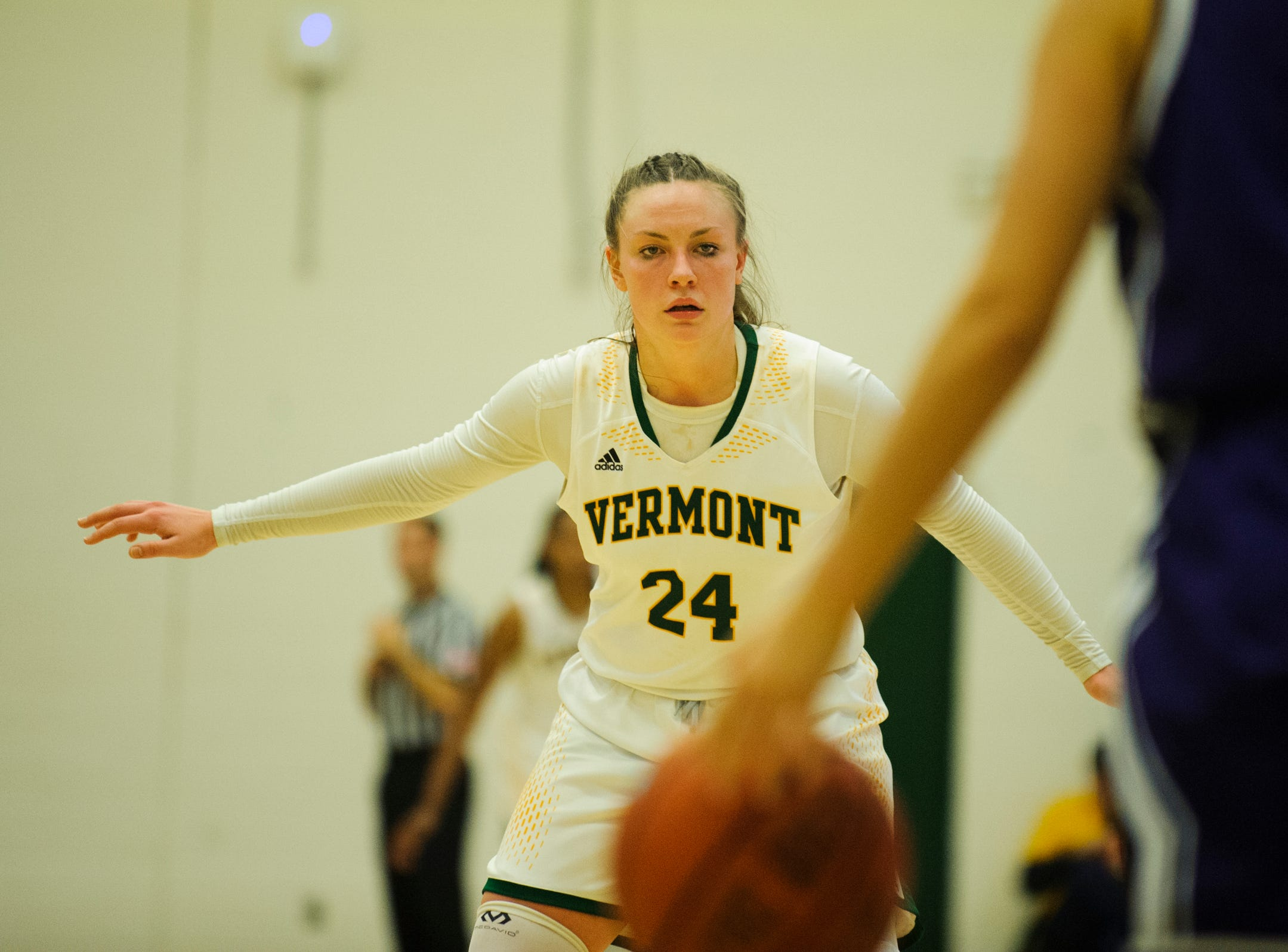 Vermont's Rose Caverly (24) keeps an eye on the ball during the women's basketball game between the Holy Cross Crusaders and the Vermont Catamounts at Patrick Gym on Wednesday night November 28, 2018 in Burlington.