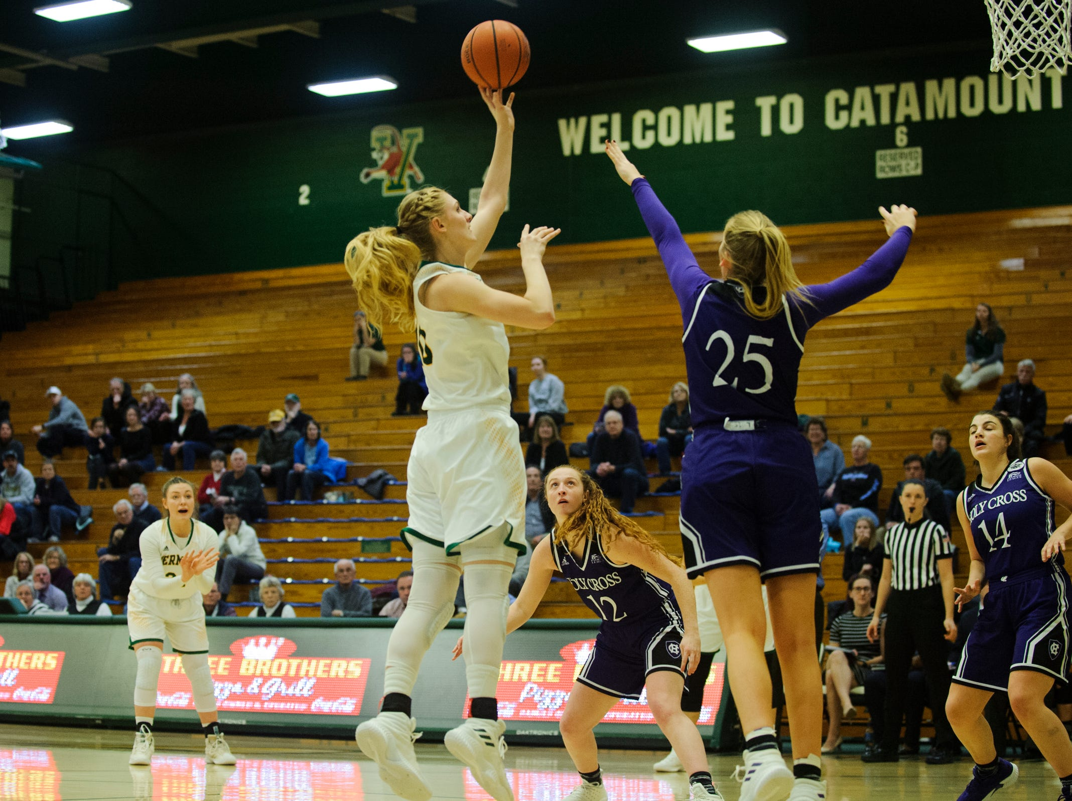 Vermont's Hannah Crymble (10) leaps to shoot the ball during the women's basketball game between the Holy Cross Crusaders and the Vermont Catamounts at Patrick Gym on Wednesday night November 28, 2018 in Burlington.