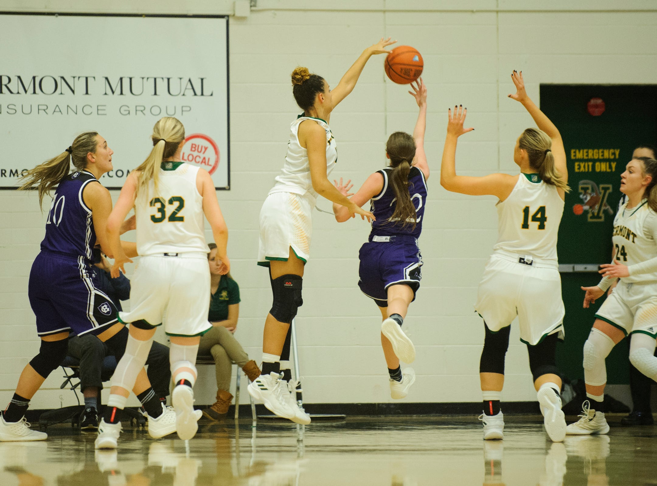 Vermont's Candice Wright (11) blocks the shot by Holy Cross' Nicole Morris (22) during the women's basketball game between the Holy Cross Crusaders and the Vermont Catamounts at Patrick Gym on Wednesday night November 28, 2018 in Burlington.