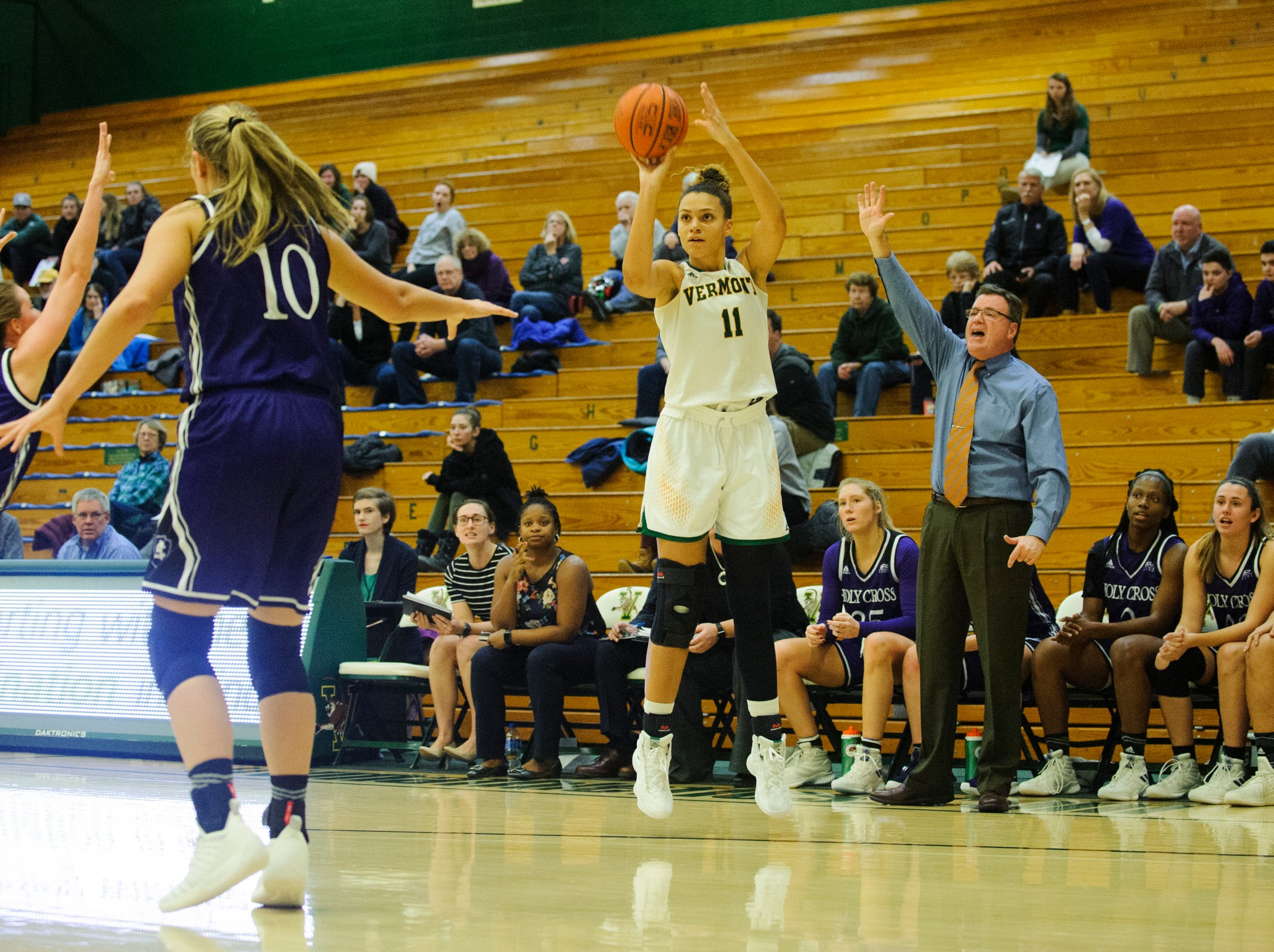 Vermont's Candice Wright (11) shoots a three pointer during the women's basketball game between the Holy Cross Crusaders and the Vermont Catamounts at Patrick Gym on Wednesday night November 28, 2018 in Burlington.