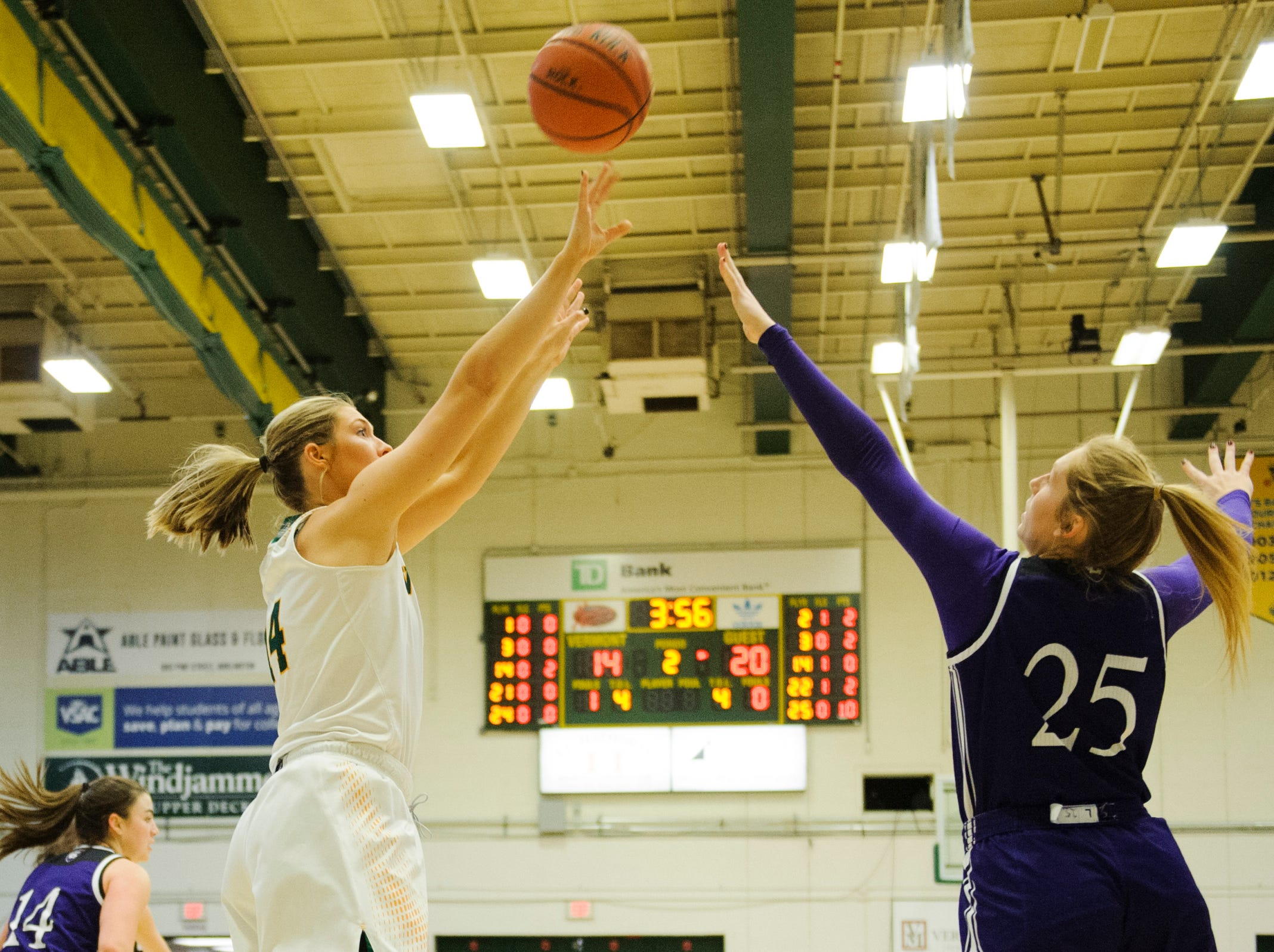 Vermont's Lauren Handy (14) shoots the ball over Holy Cross' Lauren Manis (25) during the women's basketball game between the Holy Cross Crusaders and the Vermont Catamounts at Patrick Gym on Wednesday night November 28, 2018 in Burlington.