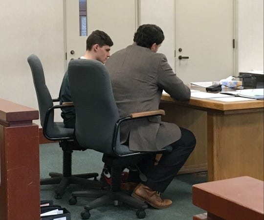 Erik Averill, 24, left, sits at the defense table with his lawyer Brian Marsicovetere during a hearing on Thursday, Nov. 29, 2018, in Vermont Superior Court in Burlington.