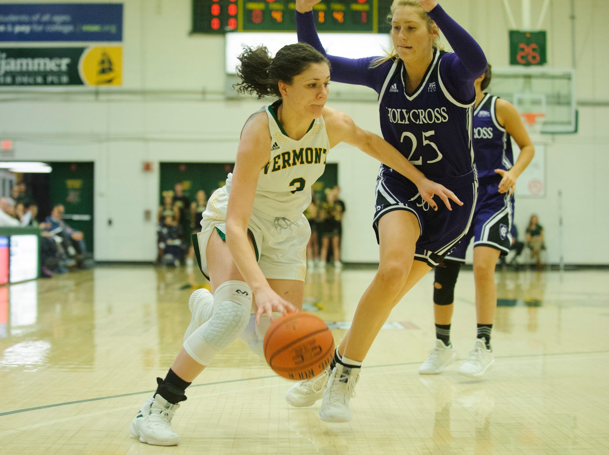 Vermont's Sarah Wells (3) drives to the hoop past Holy Cross' Lauren Manis (25) during the women's basketball game between the Holy Cross Crusaders and the Vermont Catamounts at Patrick Gym on Wednesday night November 28, 2018 in Burlington.