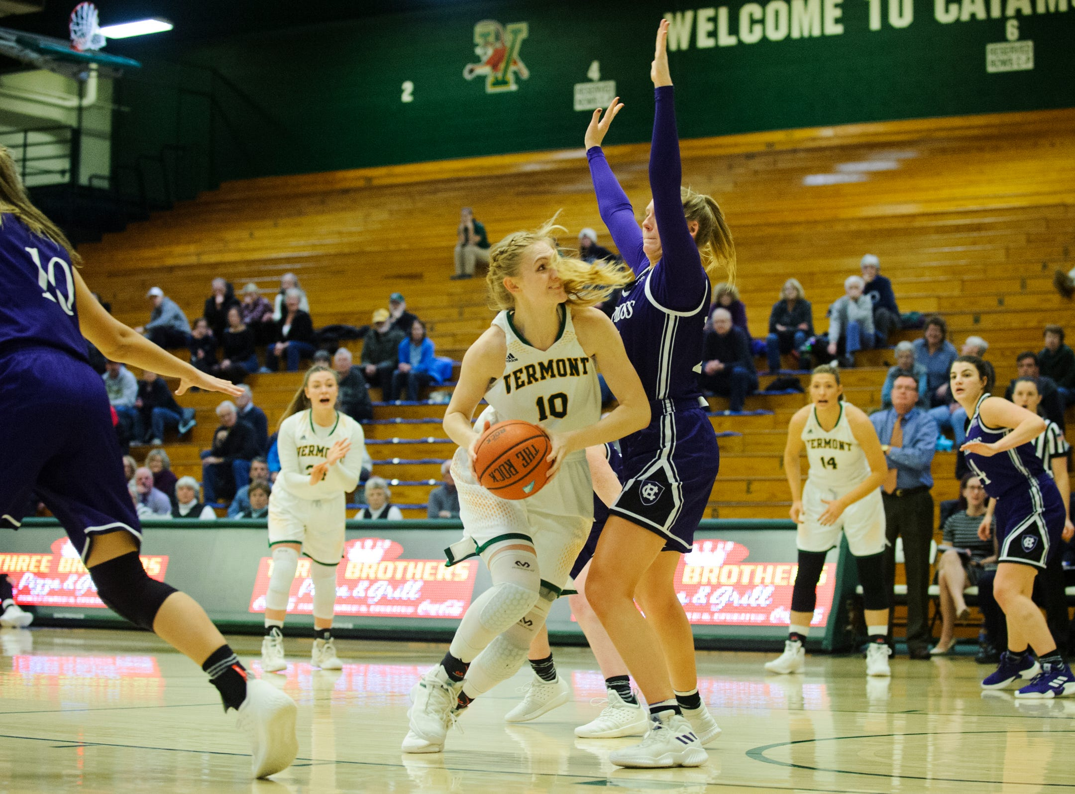 Vermont's Hannah Crymble (10) battles to shoot the ball during the women's basketball game between the Holy Cross Crusaders and the Vermont Catamounts at Patrick Gym on Wednesday night November 28, 2018 in Burlington.