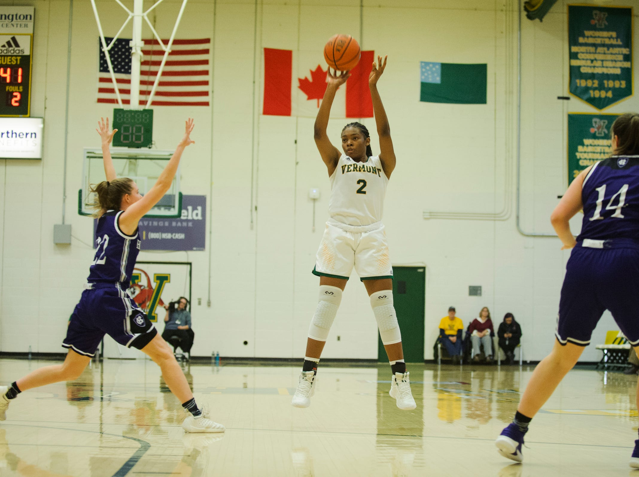 Vermont's Nicole Crum (2) shoots a three pointer during the women's basketball game between the Holy Cross Crusaders and the Vermont Catamounts at Patrick Gym on Wednesday night November 28, 2018 in Burlington.
