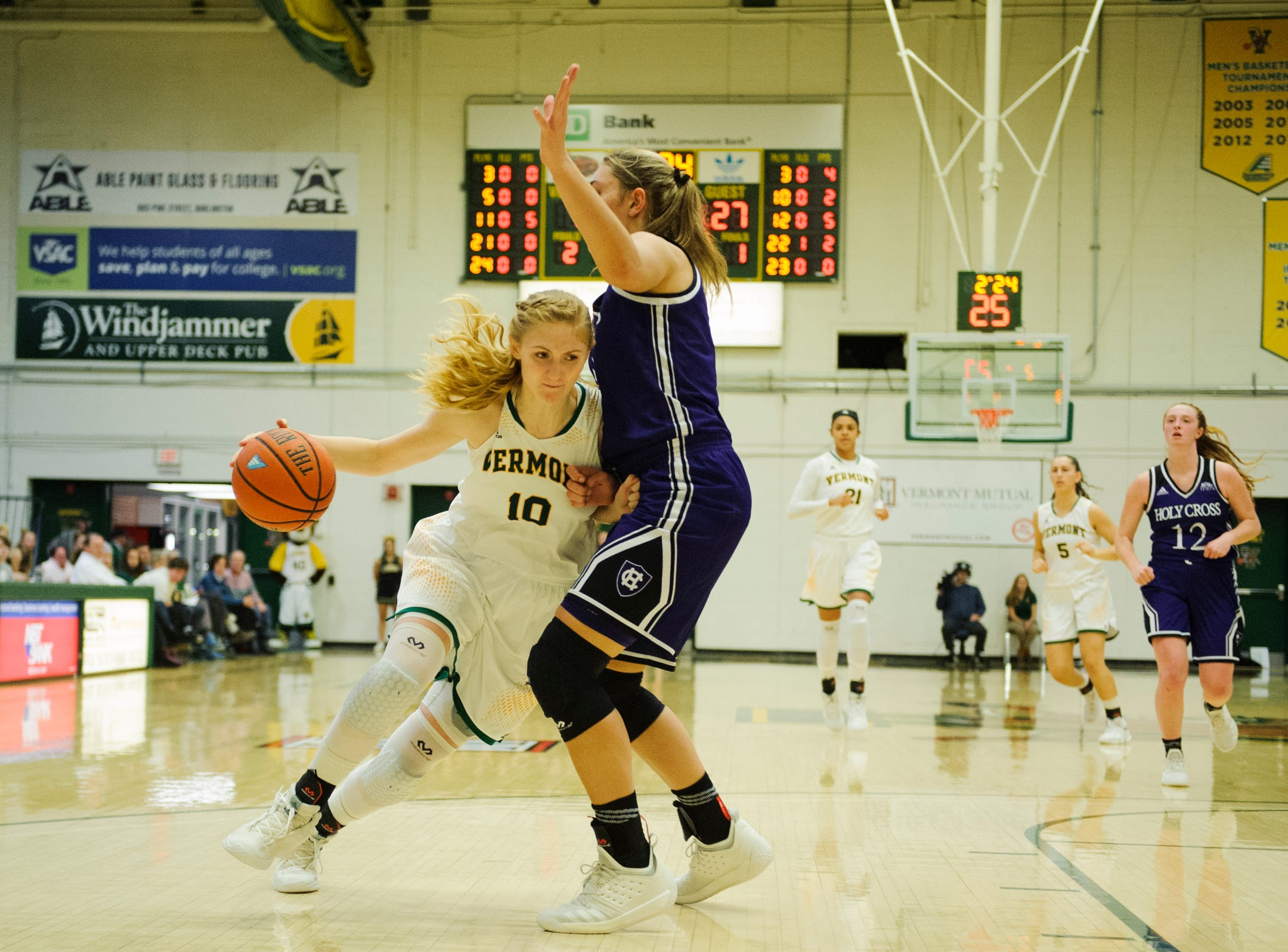 Vermont's Hannah Crymble drives to the hoop during the women's basketball game between the Holy Cross Crusaders and the Vermont Catamounts at Patrick Gym on Wednesday night November 28, 2018 in Burlington.