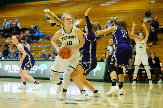 Vermont's Hannah Crymble (10) looks to take a shot during the women's basketball game between the Holy Cross Crusaders and the Vermont Catamounts at Patrick Gym on Wednesday night November 28, 2018 in Burlington.