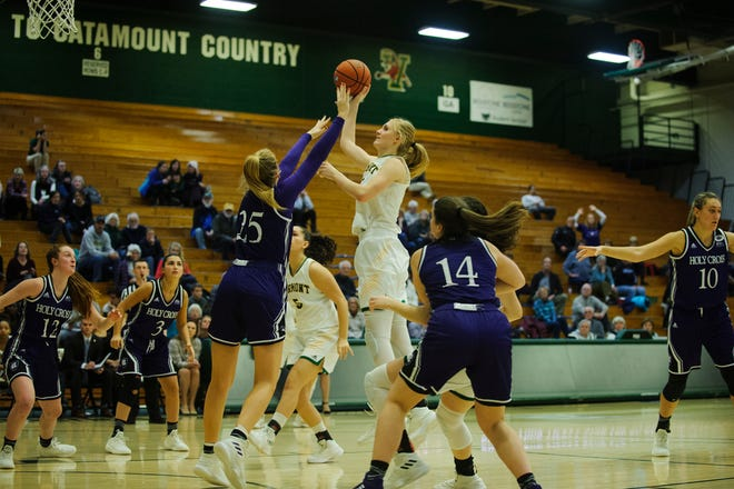 Vermont's Hannah Crymble (10) leaps to take a shot during the women's basketball game between the Holy Cross Crusaders and the Vermont Catamounts at Patrick Gym on Nov. 28. On Saturday, Crymble, a junior, cleared 1,000 career points.