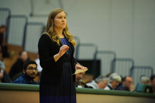 Women's basketball coach Alisa Kresge had the interim tag officially removed, the University of Vermont athletic department announced during a news conference Tuesday.