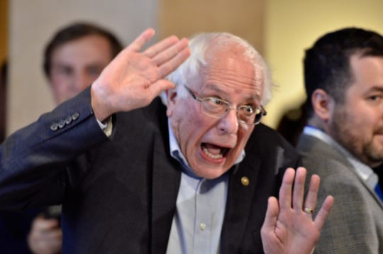 "Sen. Bernie Sanders, I-Vt., gives an exaggerated reaction when told a reporter with The New York Times was covering The Sanders Institute Gathering Thursday, Nov. 29, 2018, in Burlington.  The Gathering is billed as a meeting of  ""250 leading progressive minds to envision – and to actualize – a better future for our country and the world,' organized by the institute co-founded by Sanders' wife, Jane O'Meara Sanders."