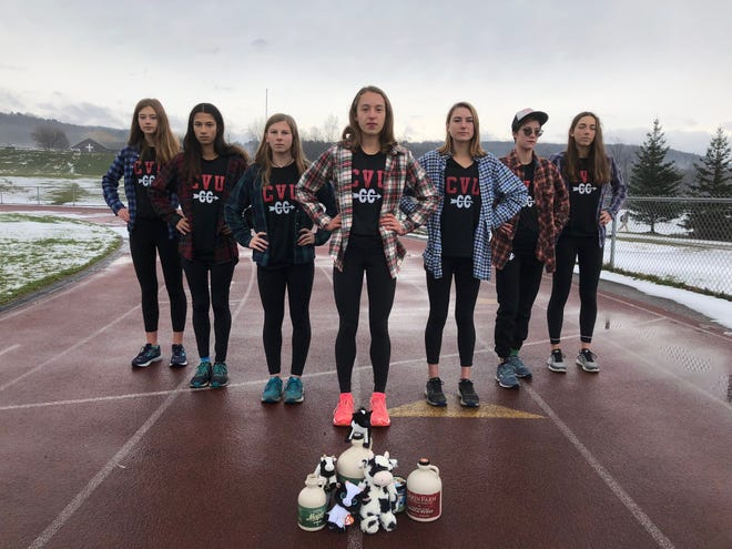 The Champlain Valley girls cross-country team -- from left: Chloe Silverman, Jasmine Nails, Alicia Veronneau, Ella Whitman, Cate Noel, Alice Larson and Sadie Holmes -- poses for a photo on the school's track earlier this week.
