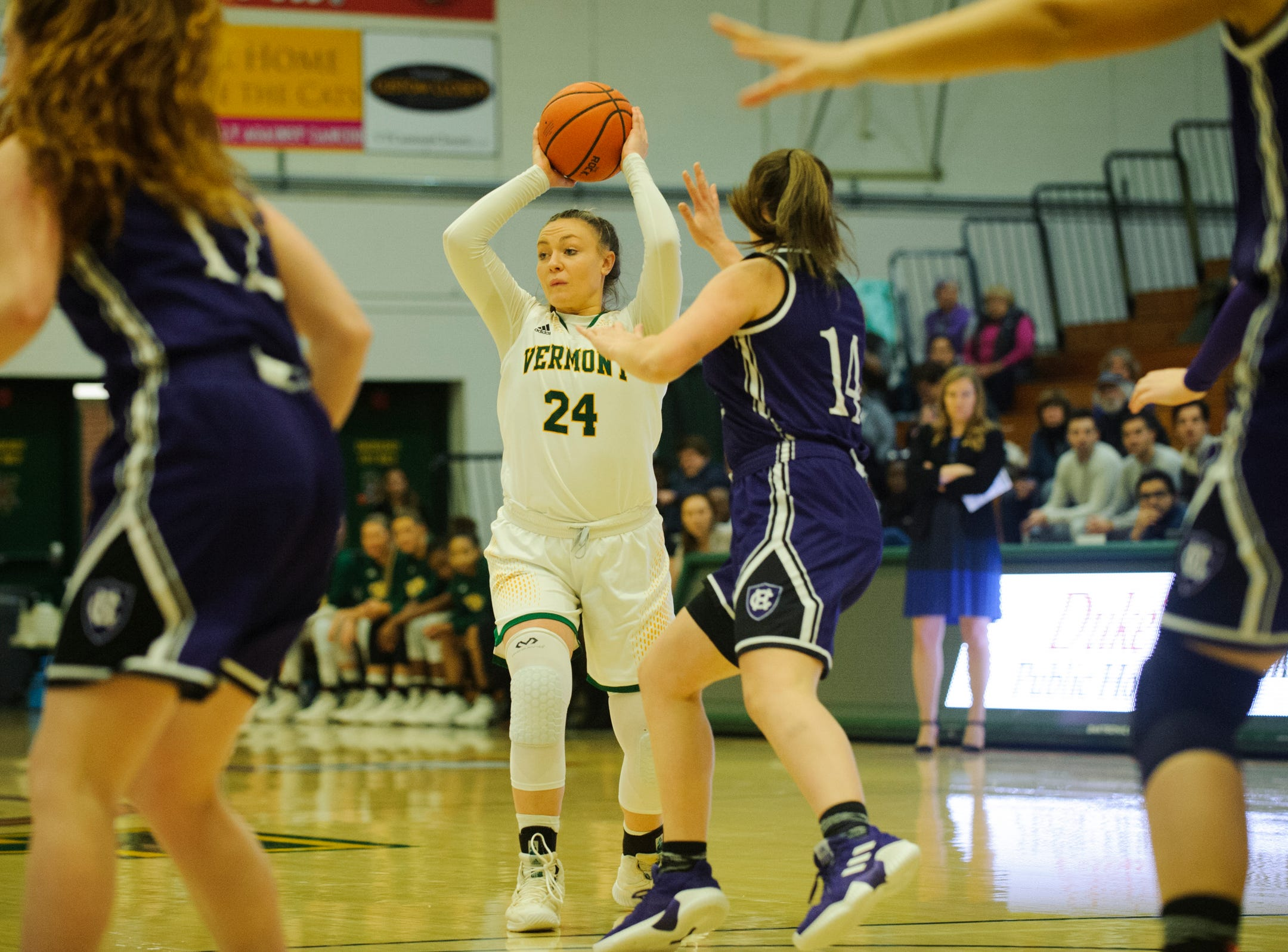 Vermont's Rose Caverly (24) looks to pass the ball during the women's basketball game between the Holy Cross Crusaders and the Vermont Catamounts at Patrick Gym on Wednesday night November 28, 2018 in Burlington.