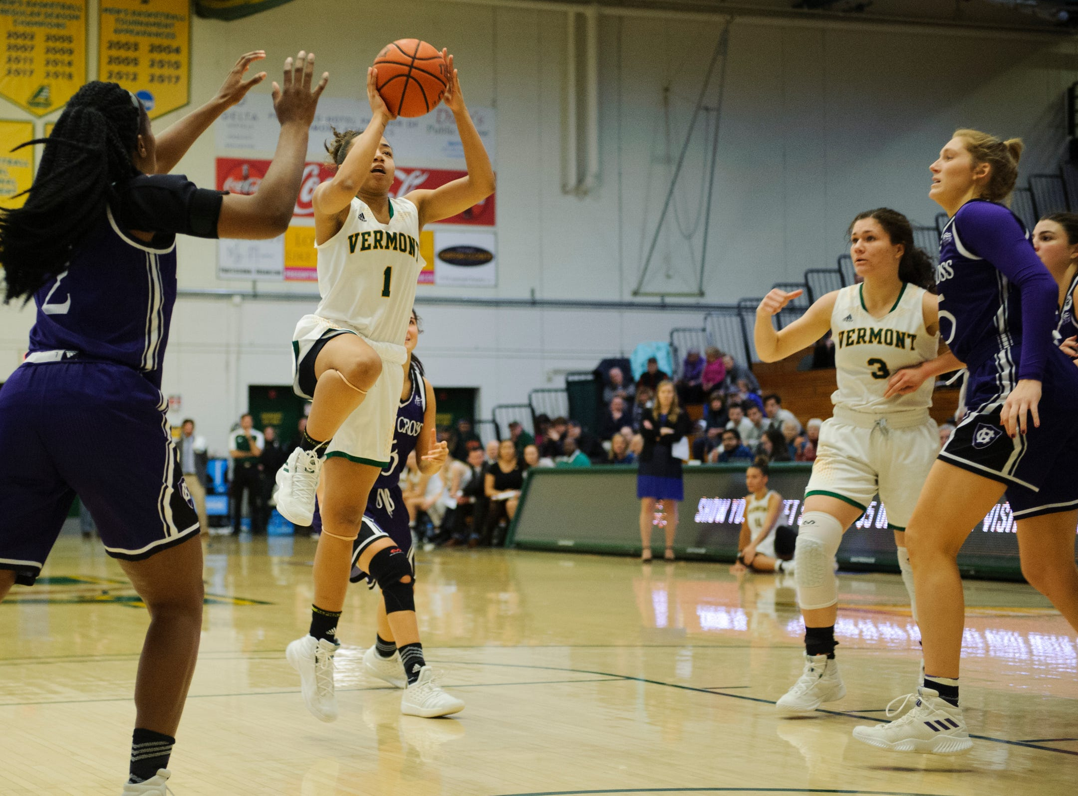 Vermont's Asha Scott (1) leaps to take a shot during the women's basketball game between the Holy Cross Crusaders and the Vermont Catamounts at Patrick Gym on Wednesday night November 28, 2018 in Burlington.