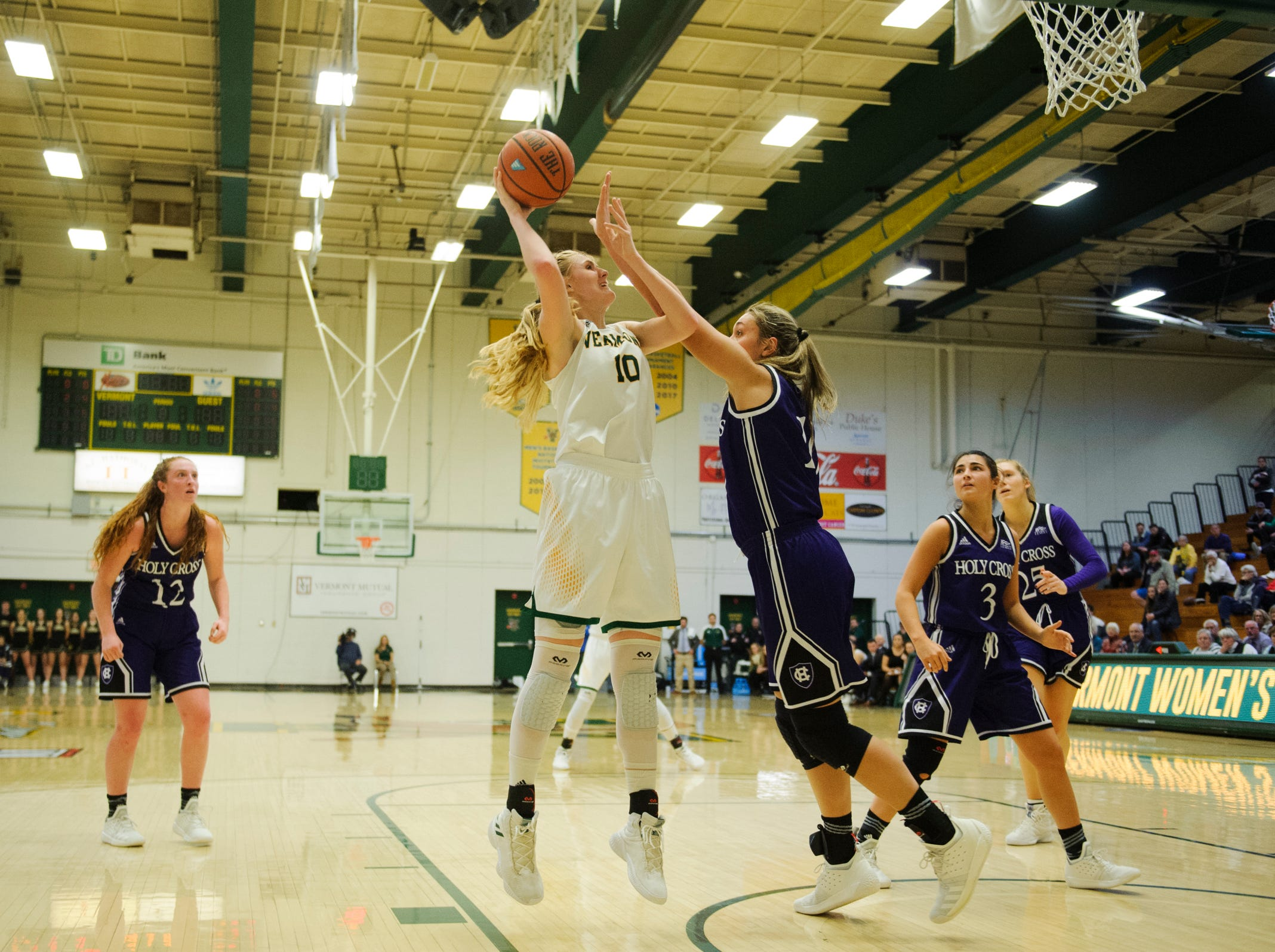 Vermont's Hannah Crymble (10) leaps to take a shot during the women's basketball game between the Holy Cross Crusaders and the Vermont Catamounts at Patrick Gym on Wednesday night November 28, 2018 in Burlington.